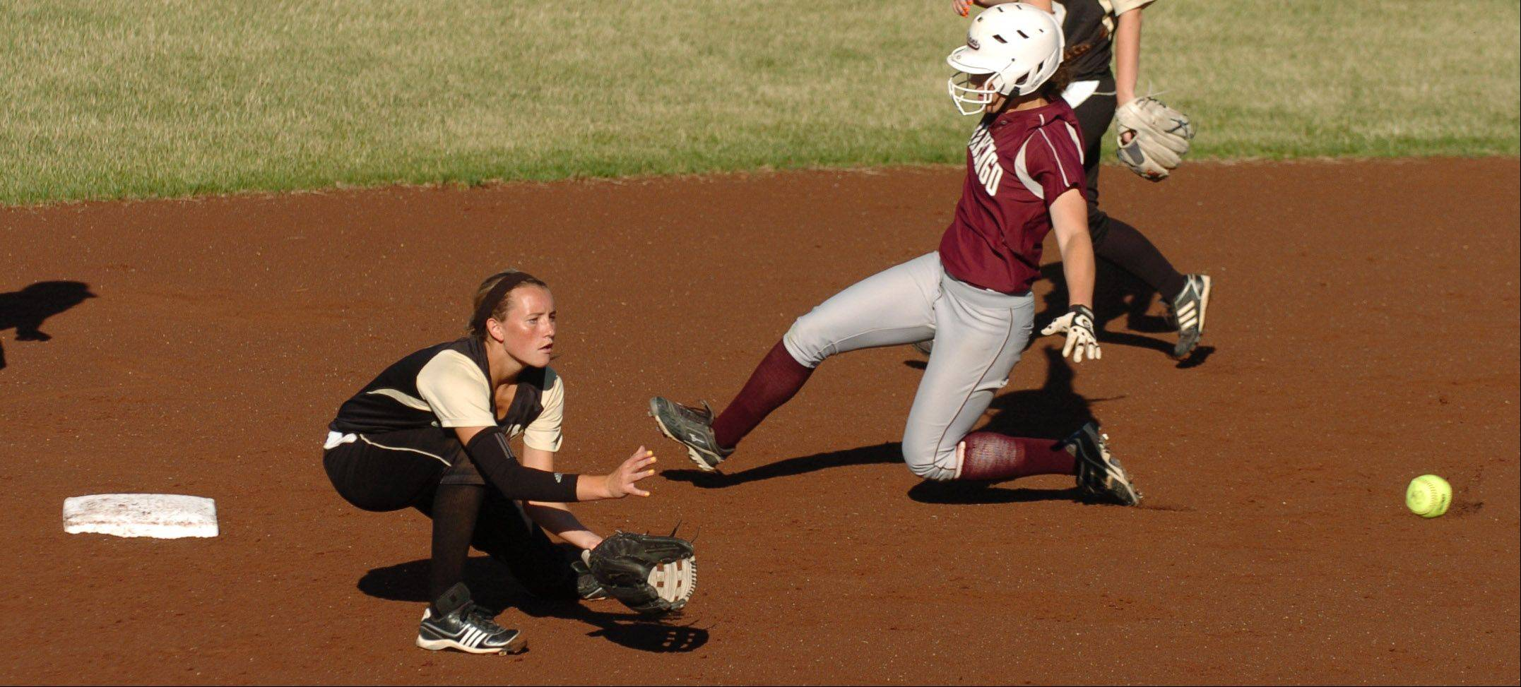 Jordyn Bowen of Grayslake North catches the ball at second base as Abby Kissack of Marengo slides in safely during Class 3A supersectional play in DeKalb.