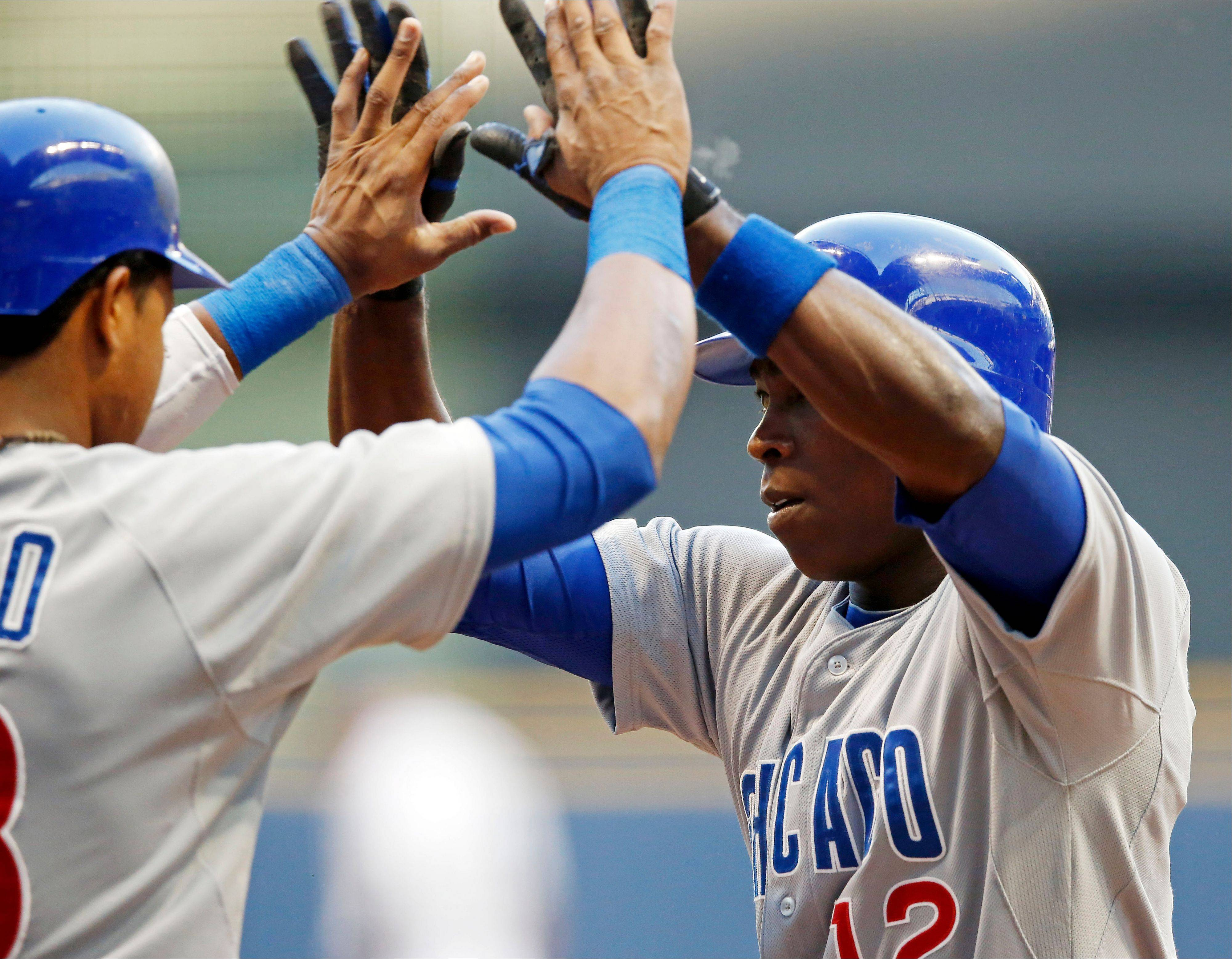 Cubs left fielder Alfonso Soriano, right, is greeted at home by Starlin Castro Tuesday after hitting a 3-run home run during the first inning of a baseball game against the Milwaukee Brewers.