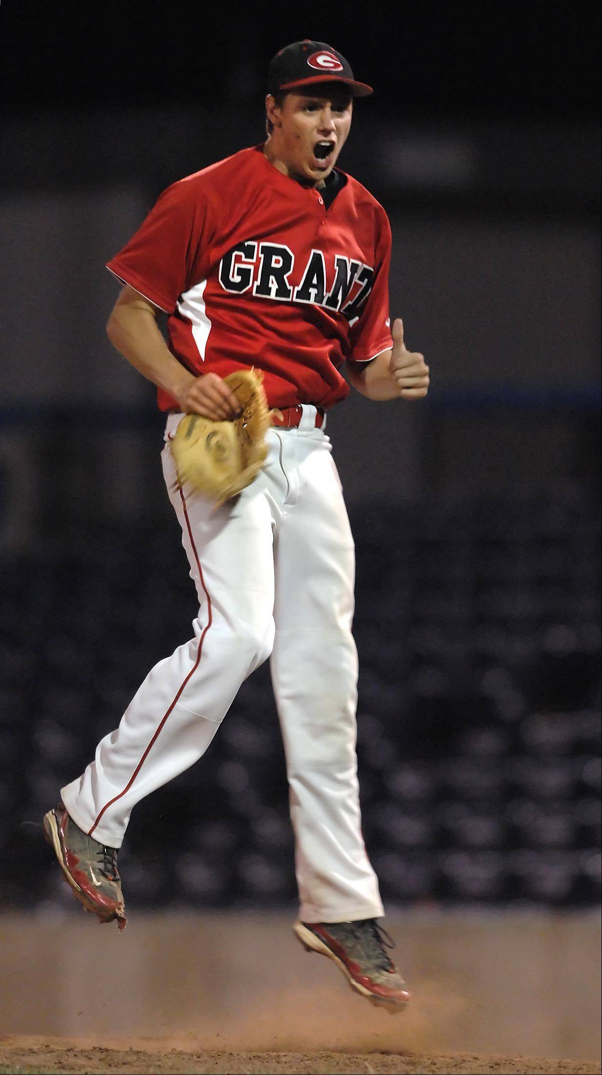 Grant pitcher Jared Helmich jumps off the mound after striking out the last batter to beat Schaumburg 7-0 in the Class 4A Rockford supersectional at Riverhawks Stadium on Monday. He allowed only 2 hits.