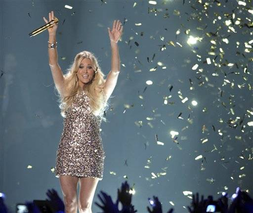 Carrie Underwood won her third video of the year award at the CMT Music Awards on Wednesday night, carving yet another great memory out for the couple in the home of the NHL's Nashville Predators.