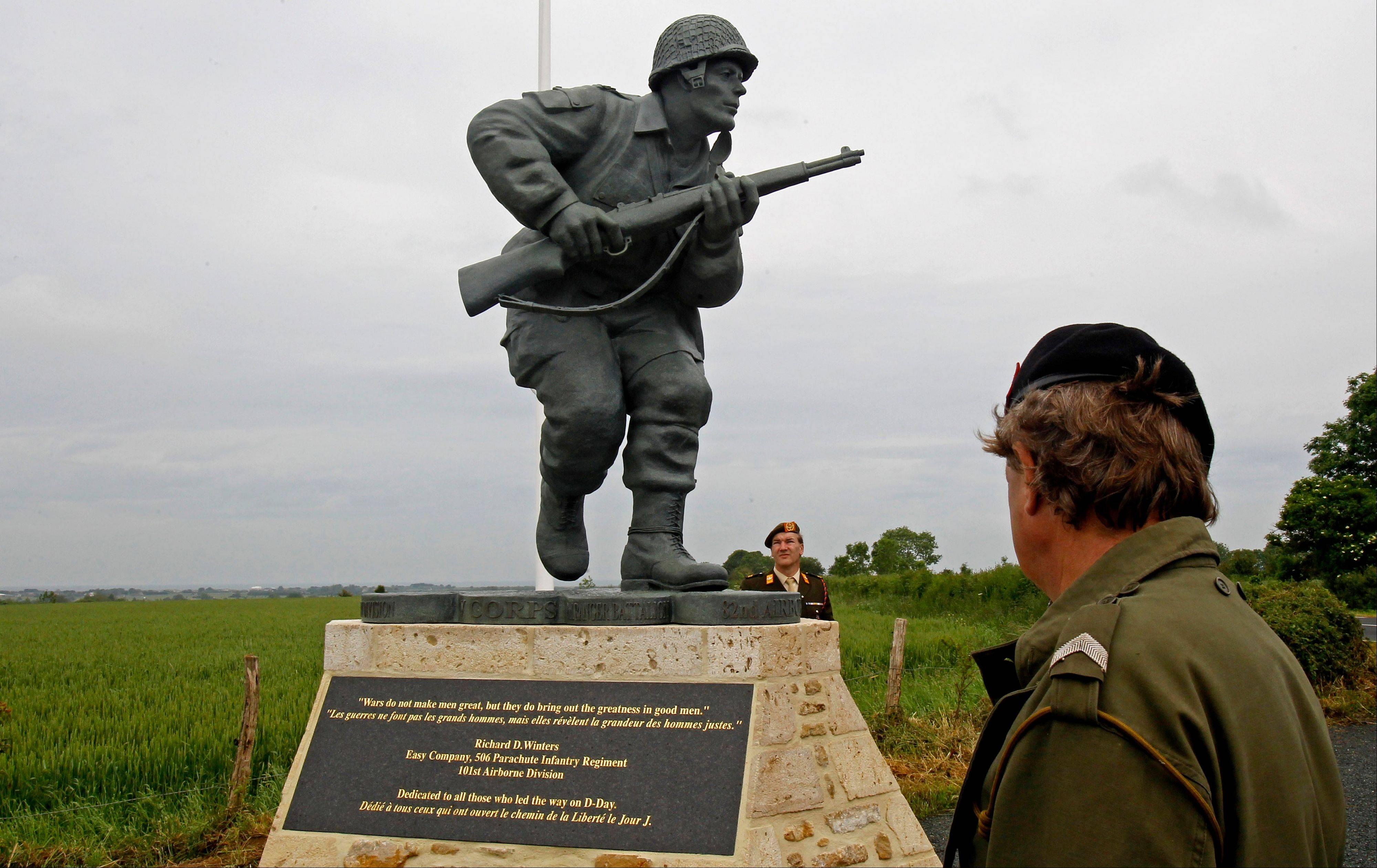 "In this picture taken on Tuesday, June 5, 2012, shows the Colorado-made statue of Pennsylvania native Maj. Dick Winters, unveiled on Wednesday, June 6, 2012 near the beaches where the D-Day invasion of France began in 1944, one of many events marking the 68th anniversary of D-Day, the Allied operation that paved the way for the end of the war. The bronze statue built near the village of Sainte Marie du Mont, is a tribute to a man whose quiet leadership was chronicled in the book and television series ""Band of Brothers."""
