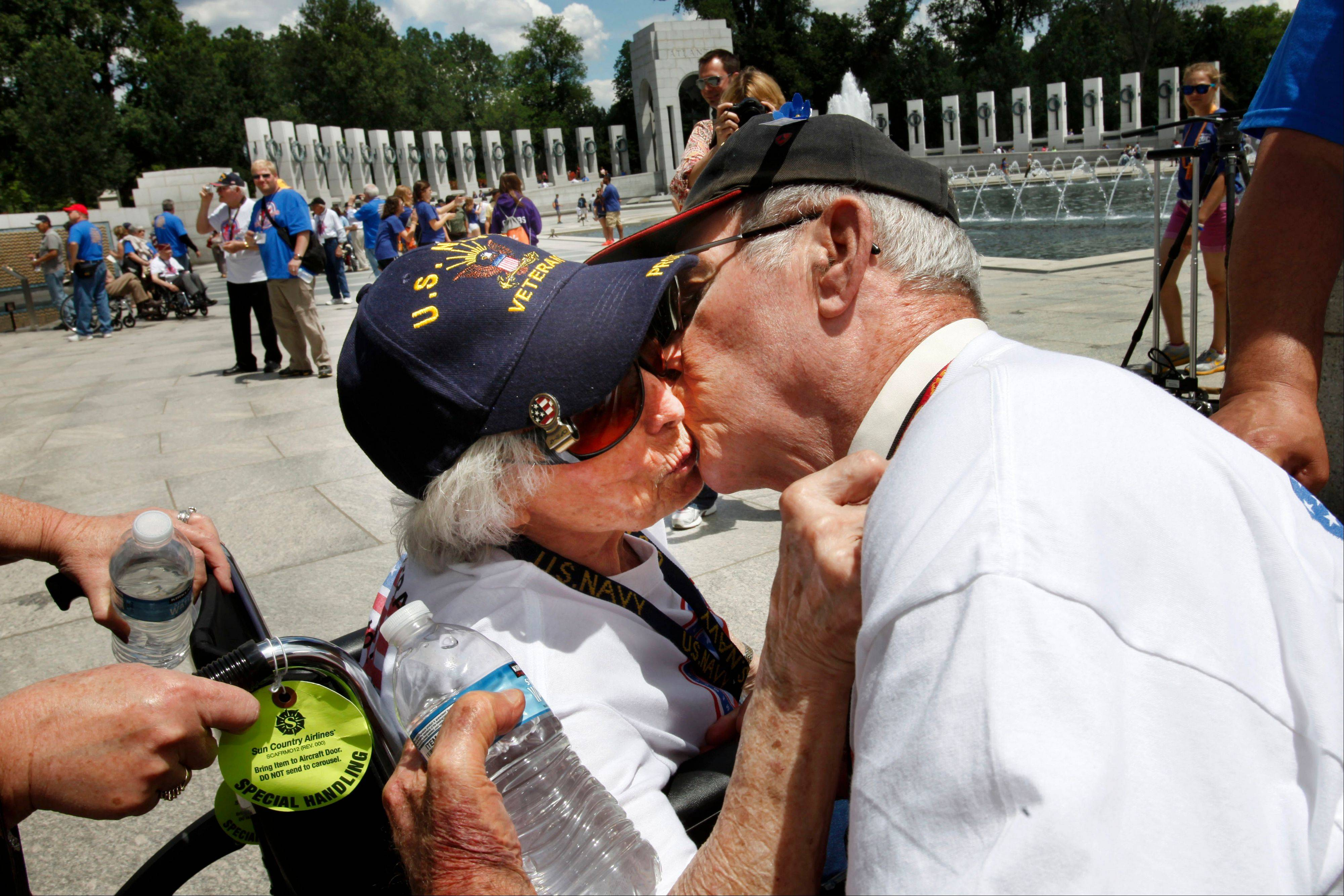 WWII Navy veteran Josephine Bussard, 89, left, and her husband WWII Marine Corps veteran Murray Bussard, 88, of Springfield, Mo., who will have been married 67 years this Friday and met during the war, kiss during a visit to the World War II Memorial in Washington, Wednesday, June 6, 2012, on the 68th anniversary of D-Day.