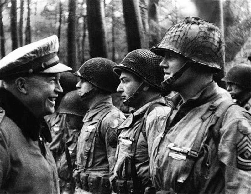 U.S. Gen, Dwight D. Eisenhower, Supreme Allied Commander, talking with men of the American Divison before the invasion.