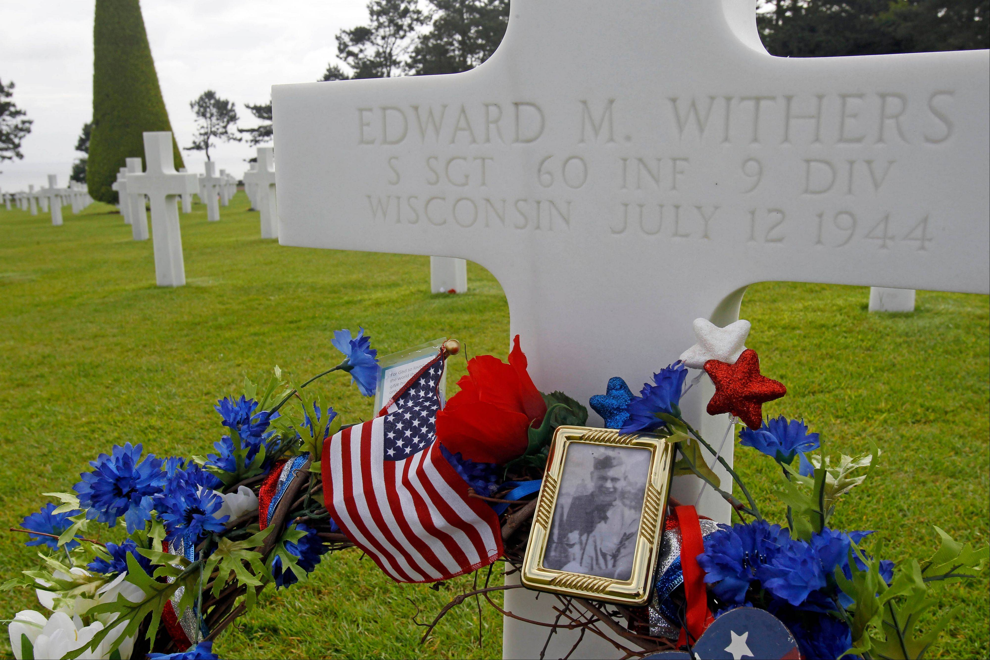 The grave of Sgt Edward M. Withers, which is among the 9,387 graves of the Colleville American military cemetery, has been decorated for the commemoration of the 68th anniversary of D-Day, in Colleville sur Mer, western France, Wednesday June 6, 2012.