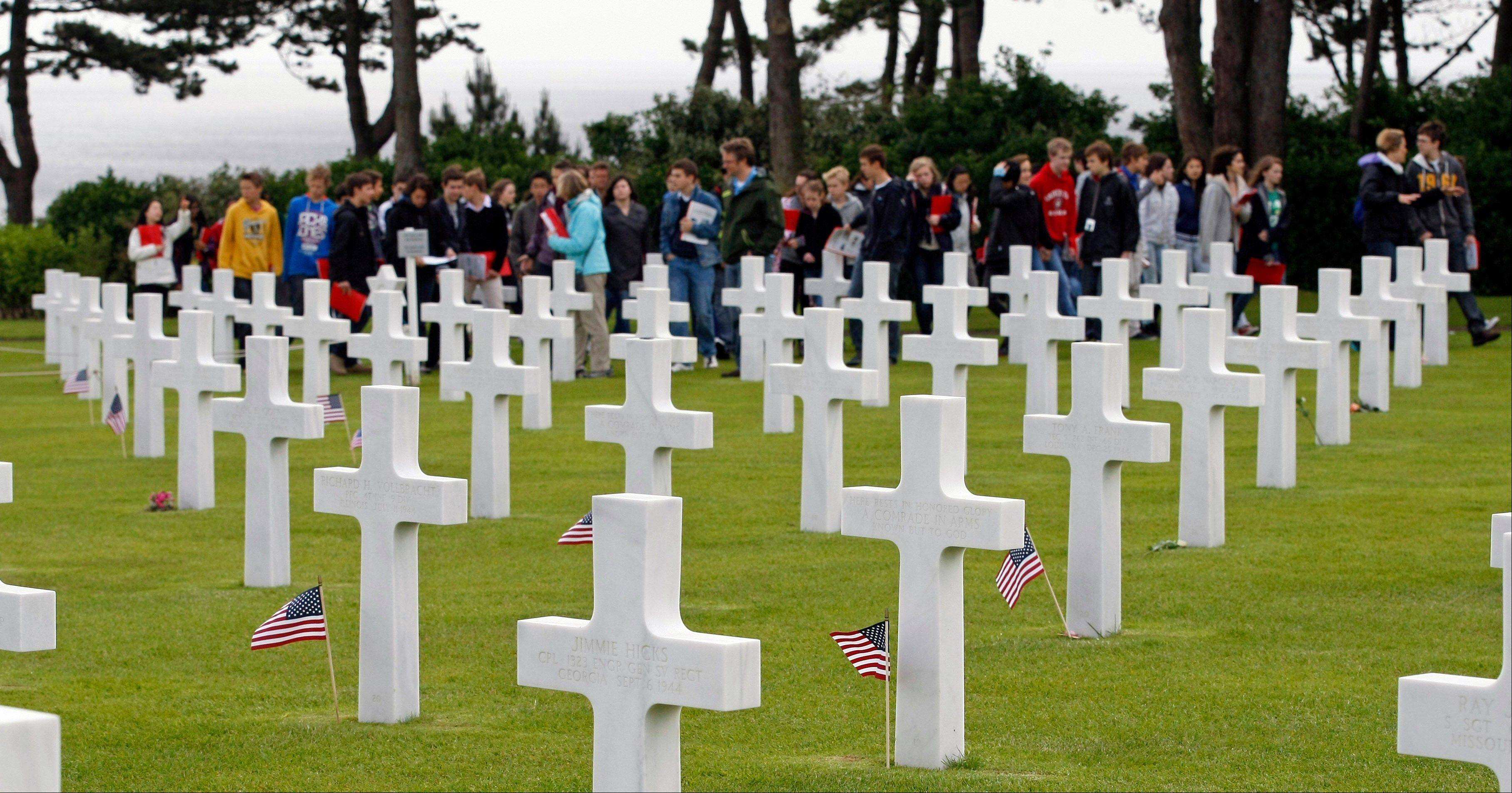 Youngsters walk among tombs at the Colleville American military cemetery, in Colleville sur Mer, western France, Wednesday June 6, 2012, during the commemoration of the 68th anniversary of the D-Day.