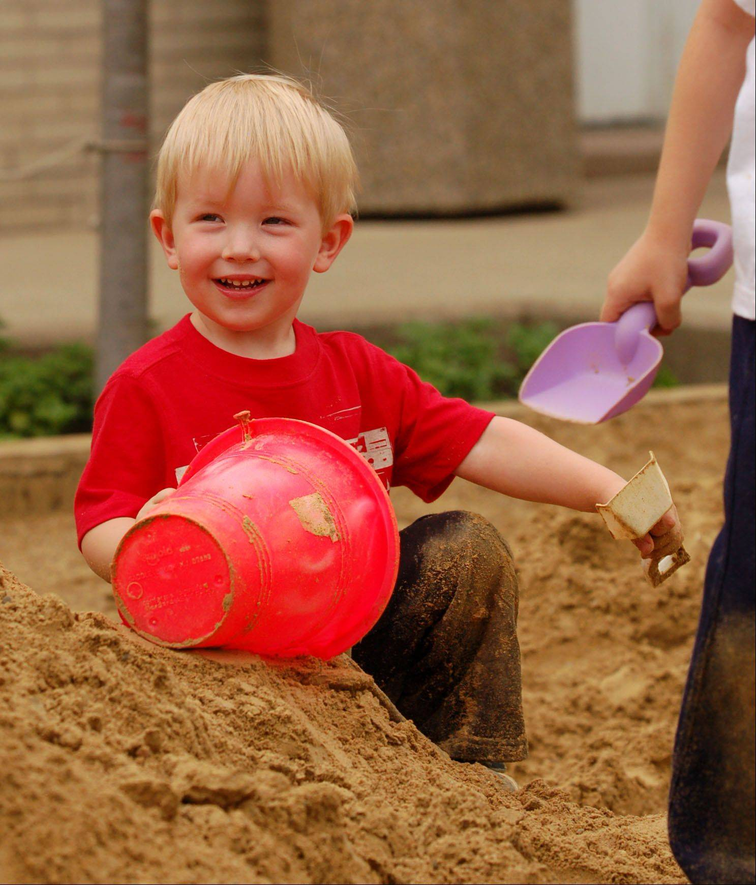 "Rowan Sather, 2, of St. Charles has a great time playing in the ""Welcome to St. Charles Beach"" sand box at last year's Pride of the Fox RiverFest. Rowan was accompanied by his mother Stephanie Sather and 4-year-old big brother Evan Sather. The family attends the festival every year."