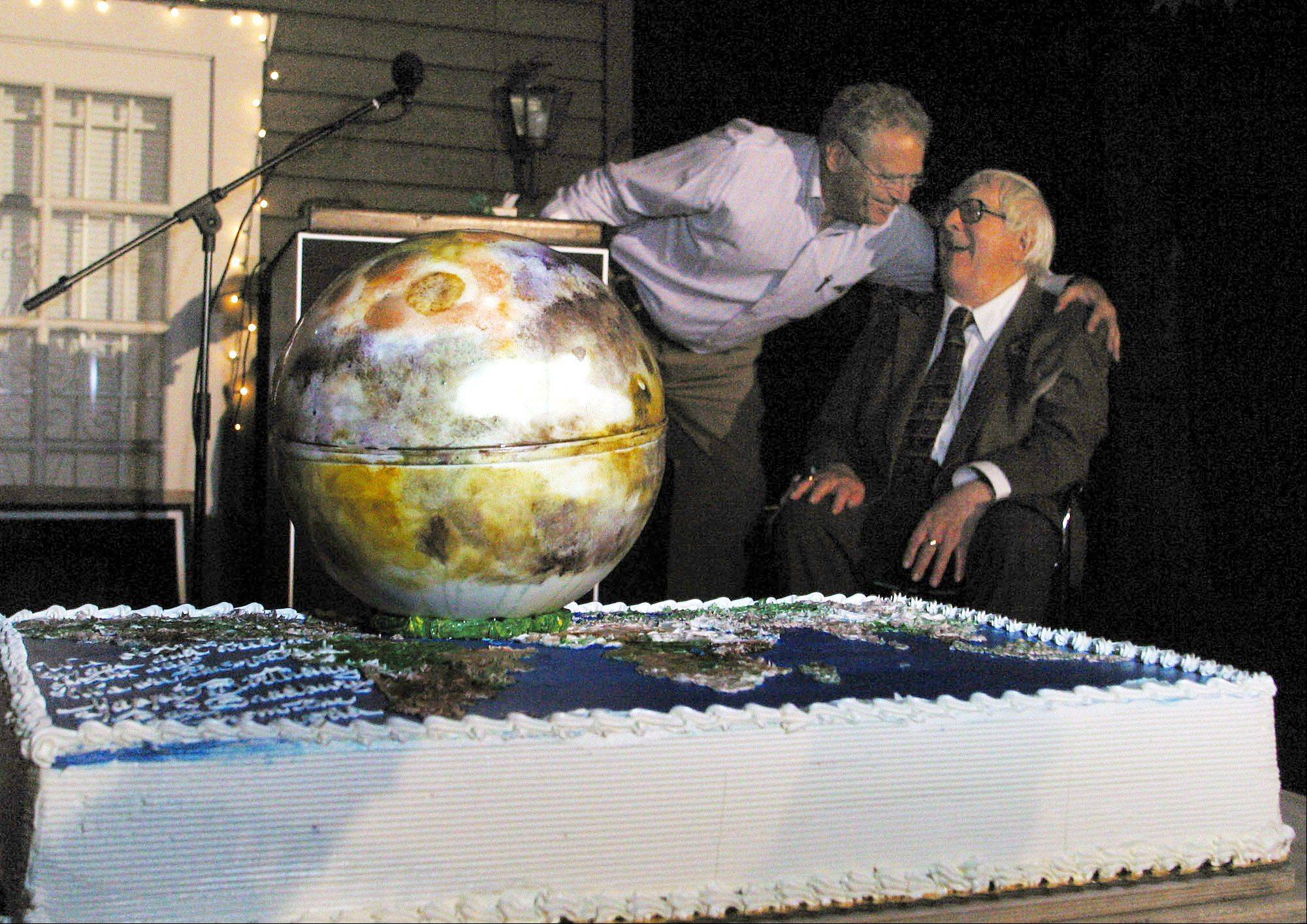"Dr. Louis Friedman, left, executive director of The Planetary Society, presents author Ray Bradbury, with a Mars-shaped cake at Bradbury's 83rd birthday party held Saturday, Aug. 23, 2003, at the Planetary Society in Pasadena, Calif. Bradbury celebrated his 83rd birthday with this wish: One night, 100 years from now, a youngster will stay up late reading his 1950 classic ""The Martian Chronicles"" with a flashlight under his blanket _ on the Red Planet."