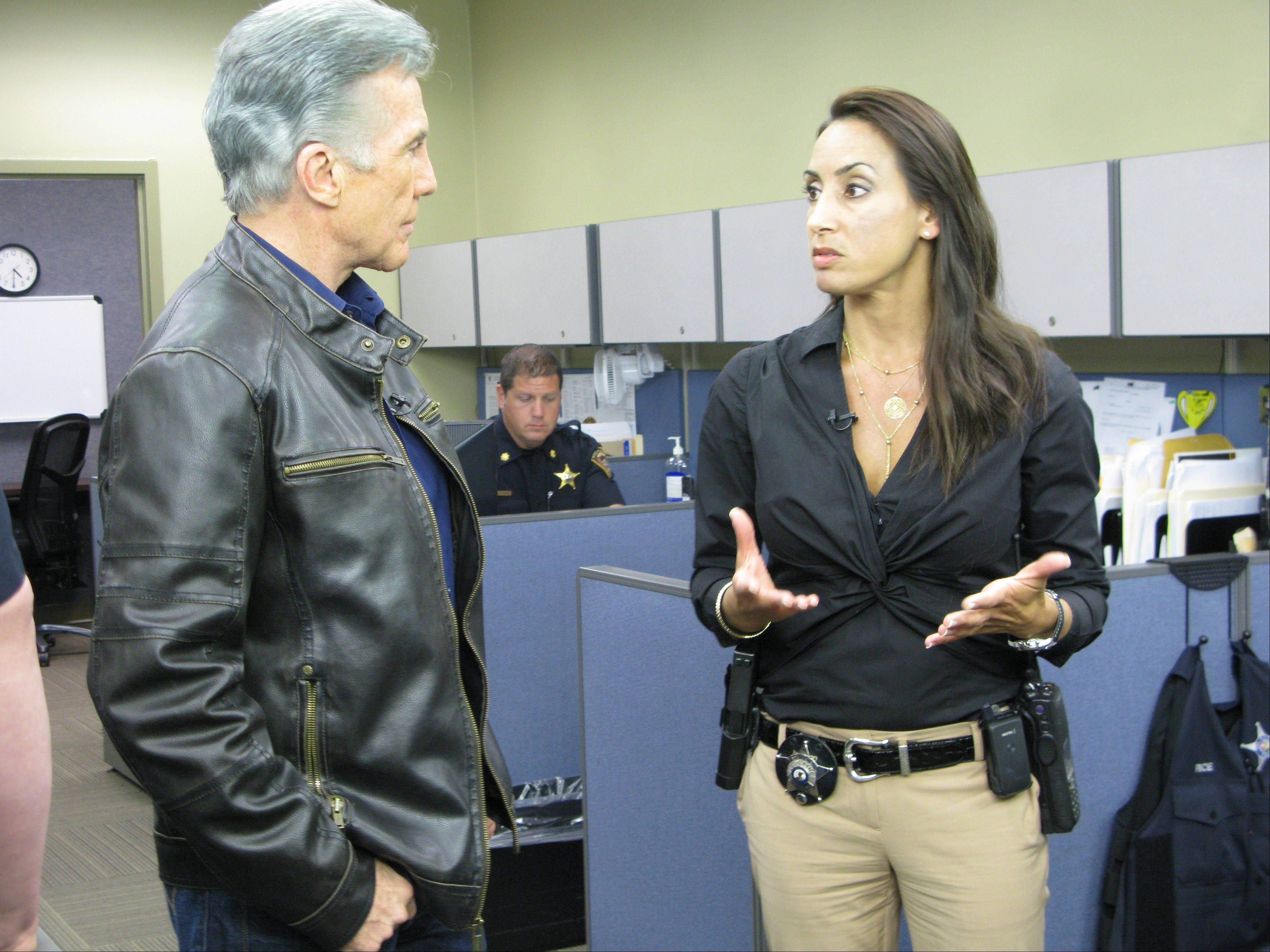 "John Walsh, host of ""America's Most Wanted,"" and Des Plaines police detective Jennifer de Pastors film the show on Tuesday."