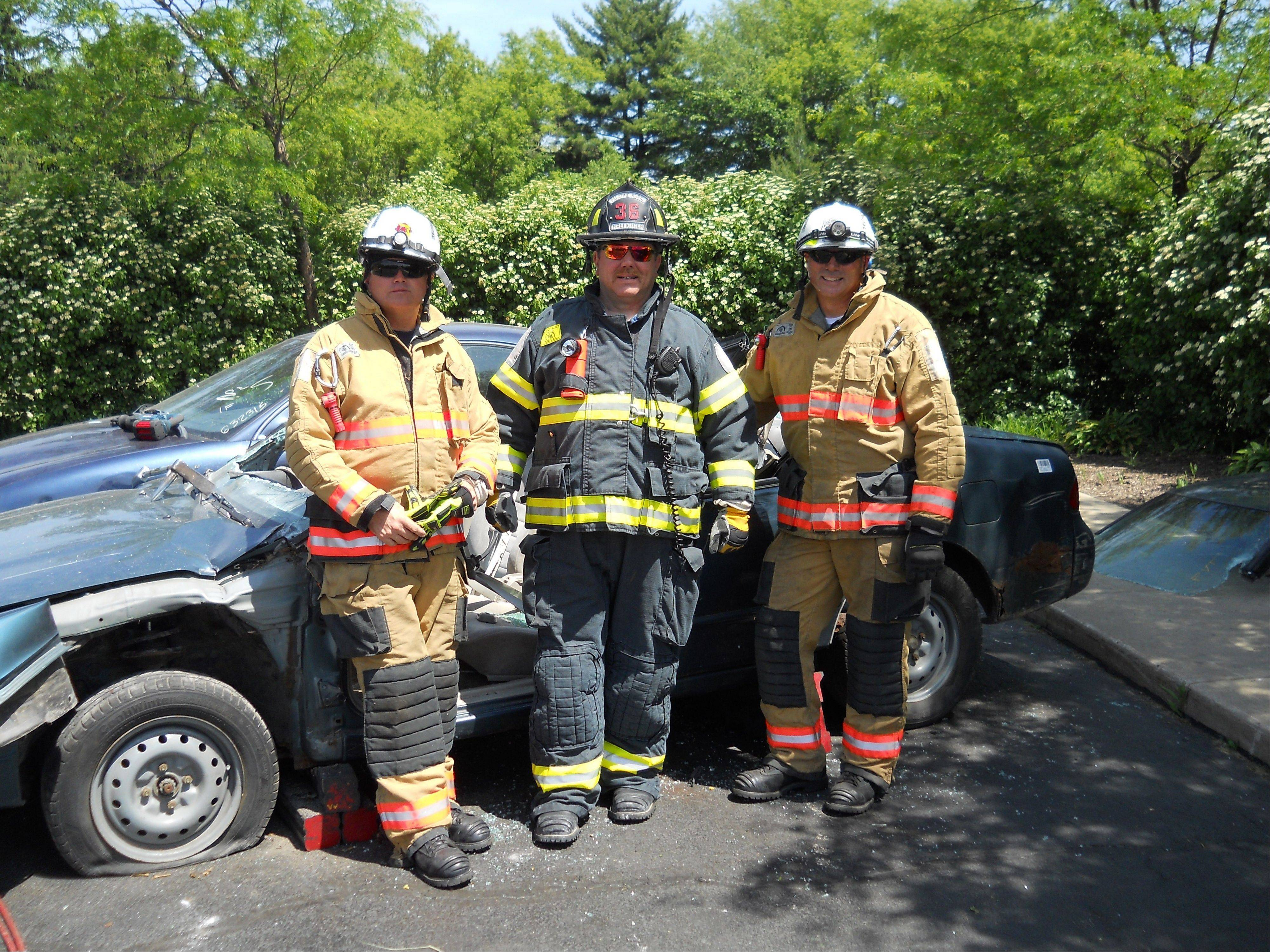 Pictured, from left, firefighters Aaron Gross and Wynn, along with Captain Clint Roberts during auto extrication training.