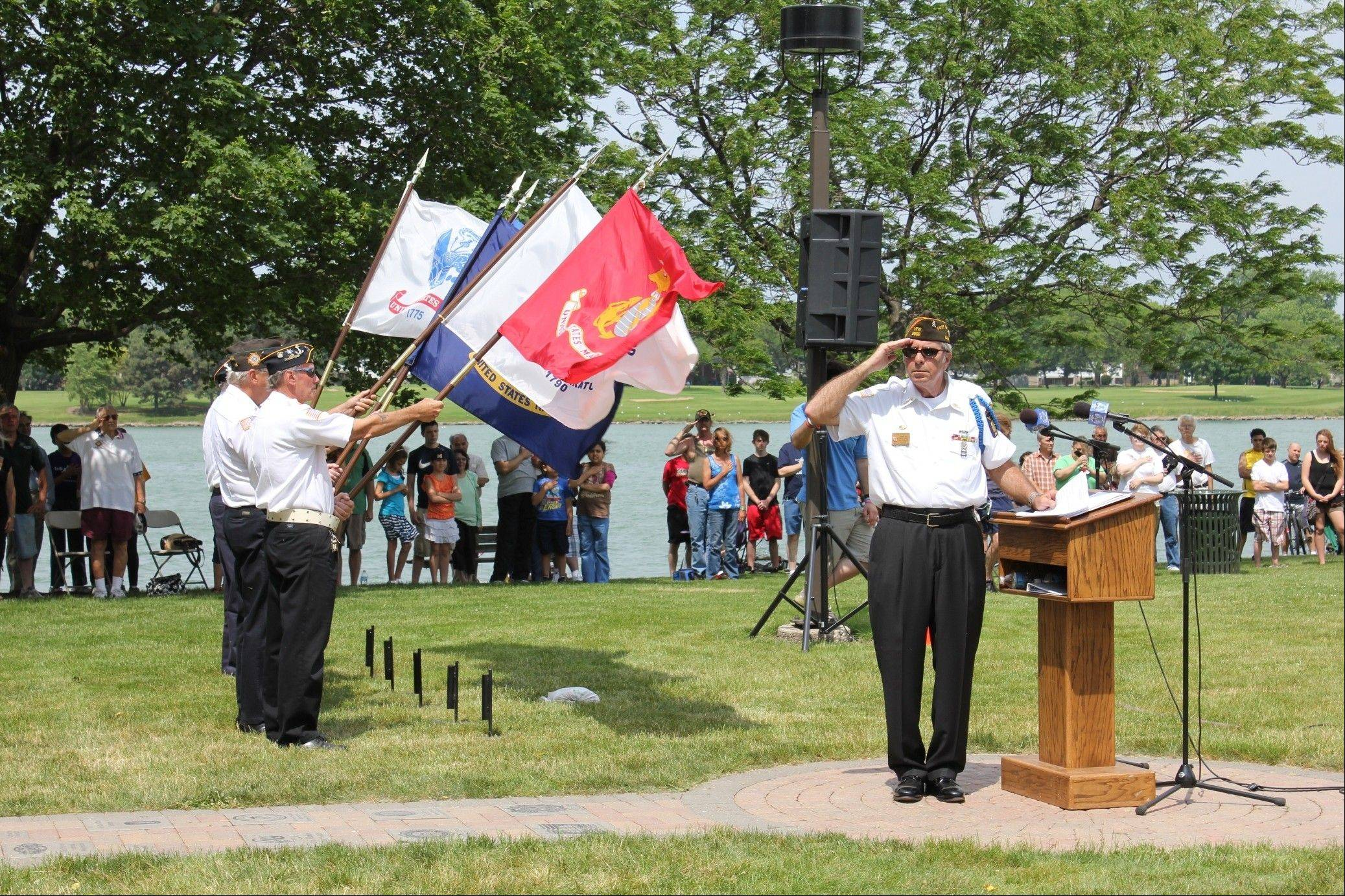 Des Plaines VFW Chaplain Steve Schaefer salutes the flag at the Des Plaines Memorial Day event. To view additional photographs visit desplaines.org/memorialday