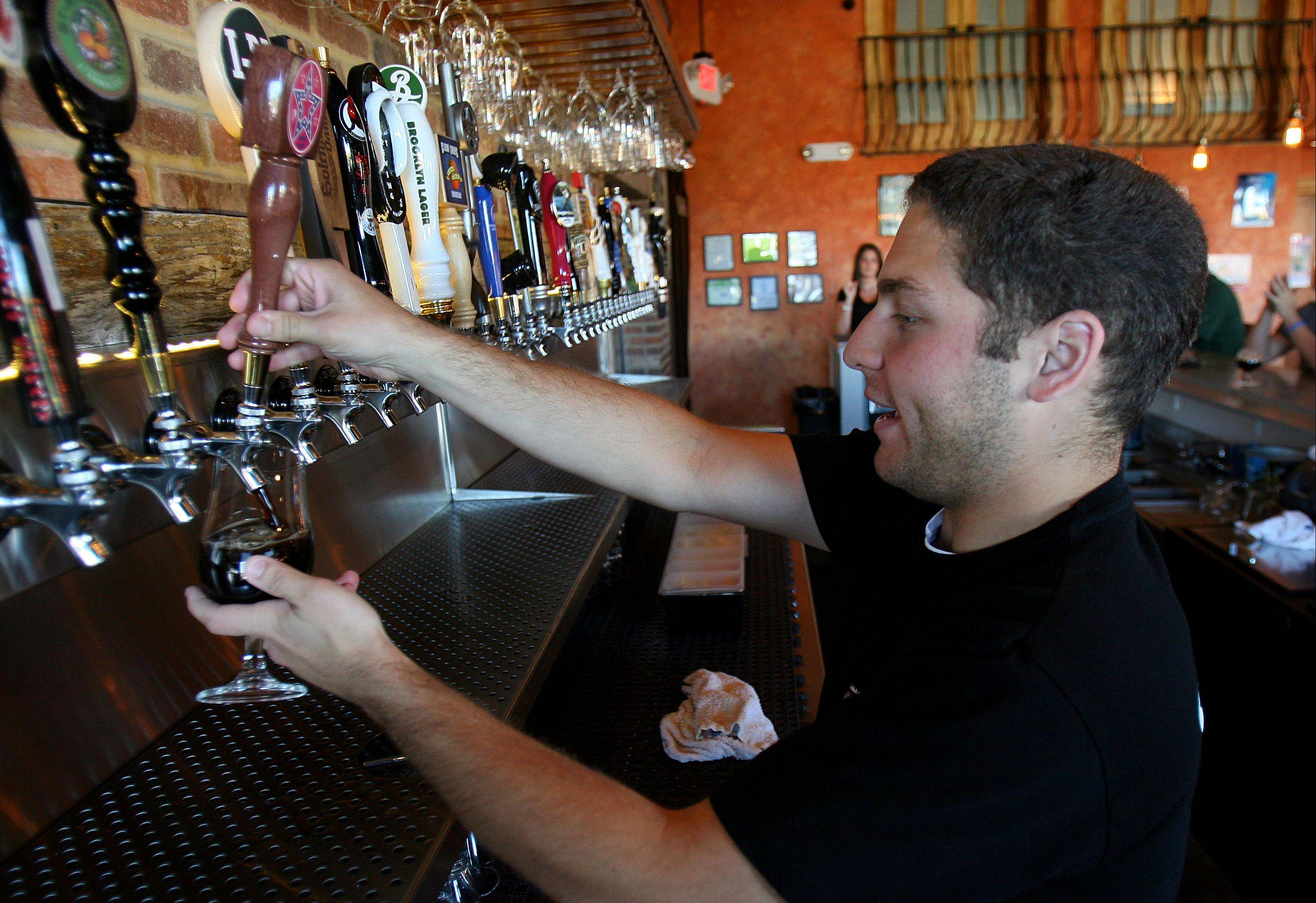 Bartender Joe Bruno pours a beer at the Beer Market in Vernon Hills.
