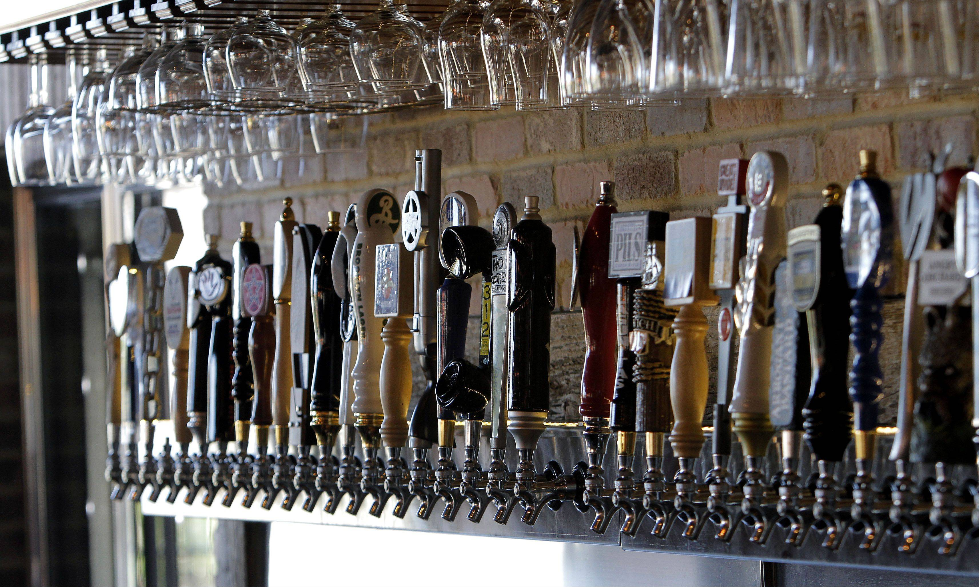 Taps line the back wall at the Beer Market in Vernon Hills.