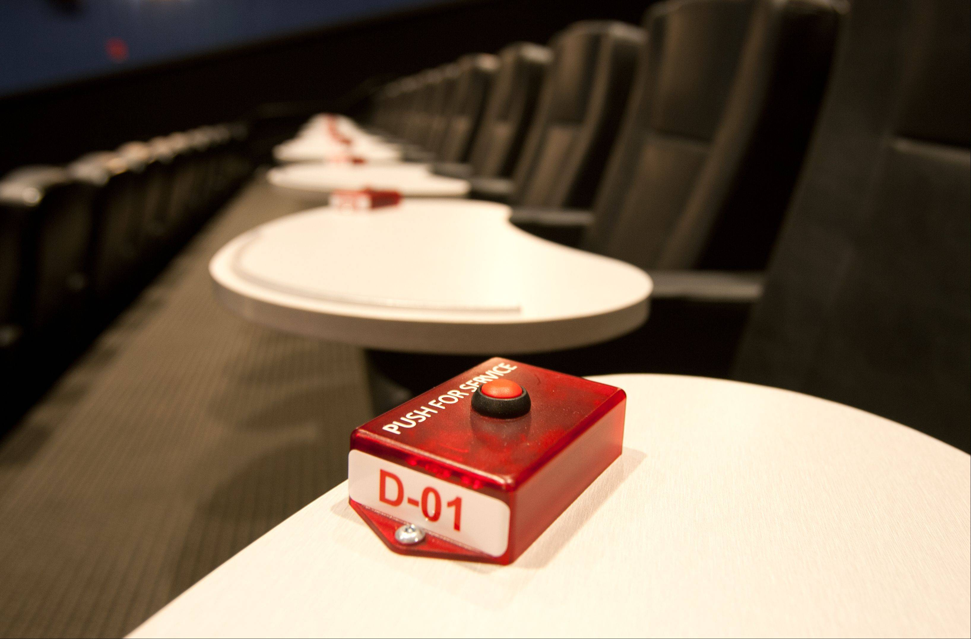 Every leather chair at the new Studio Movie Grill is equipped with a tray and buzzer for personal service.
