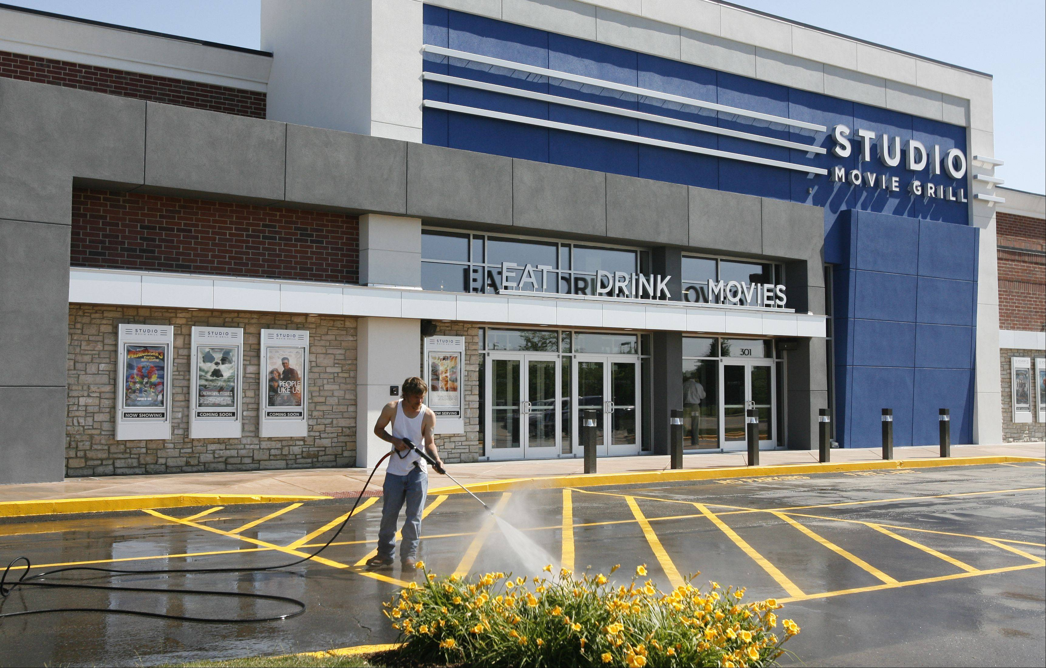 Crews put the finishing touches on the Studio Movie Grill that opens Friday evening in Wheaton. A ribbon-cutting ceremony is slated for 5:30 p.m.