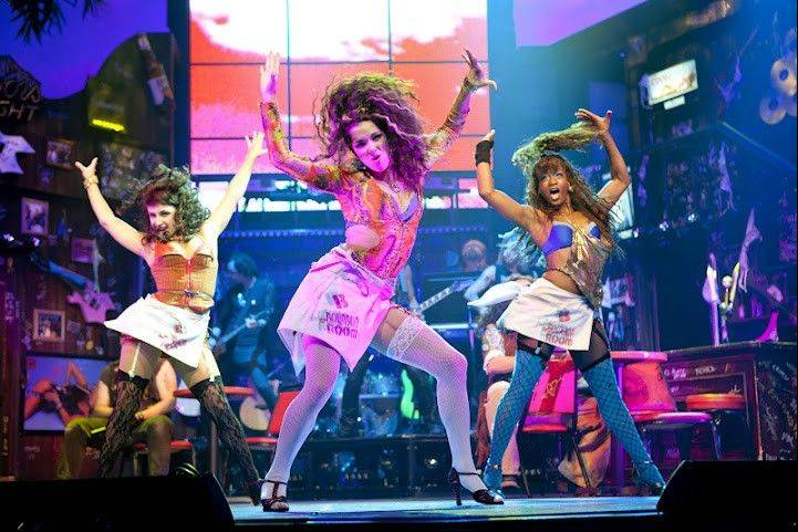 "Rock 'n' roll with a dash of sex is on display this summer at Chicago's Broadway Playhouse, which hosts a sit-down production of the jukebox musical ""Rock of Ages."""