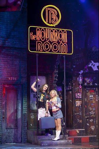 "Dominique Scott and Shannon Mullen play a couple of young adults hoping to make it big in music and the movies in the jukebox musical ""Rock of Ages,"" running through Aug. 5 at the Broadway Playhouse in Chicago."