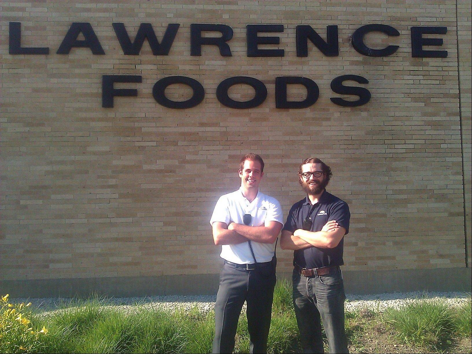 Matt Dyer, left, and Matthew Robinson stand in front of Lawrence Foods in Elk Grove Village, where they work. The two veterans will be running in the Spartan Death Race in Pittsfield, Vt., this summer to raise money for the Wounded Warriors Project.