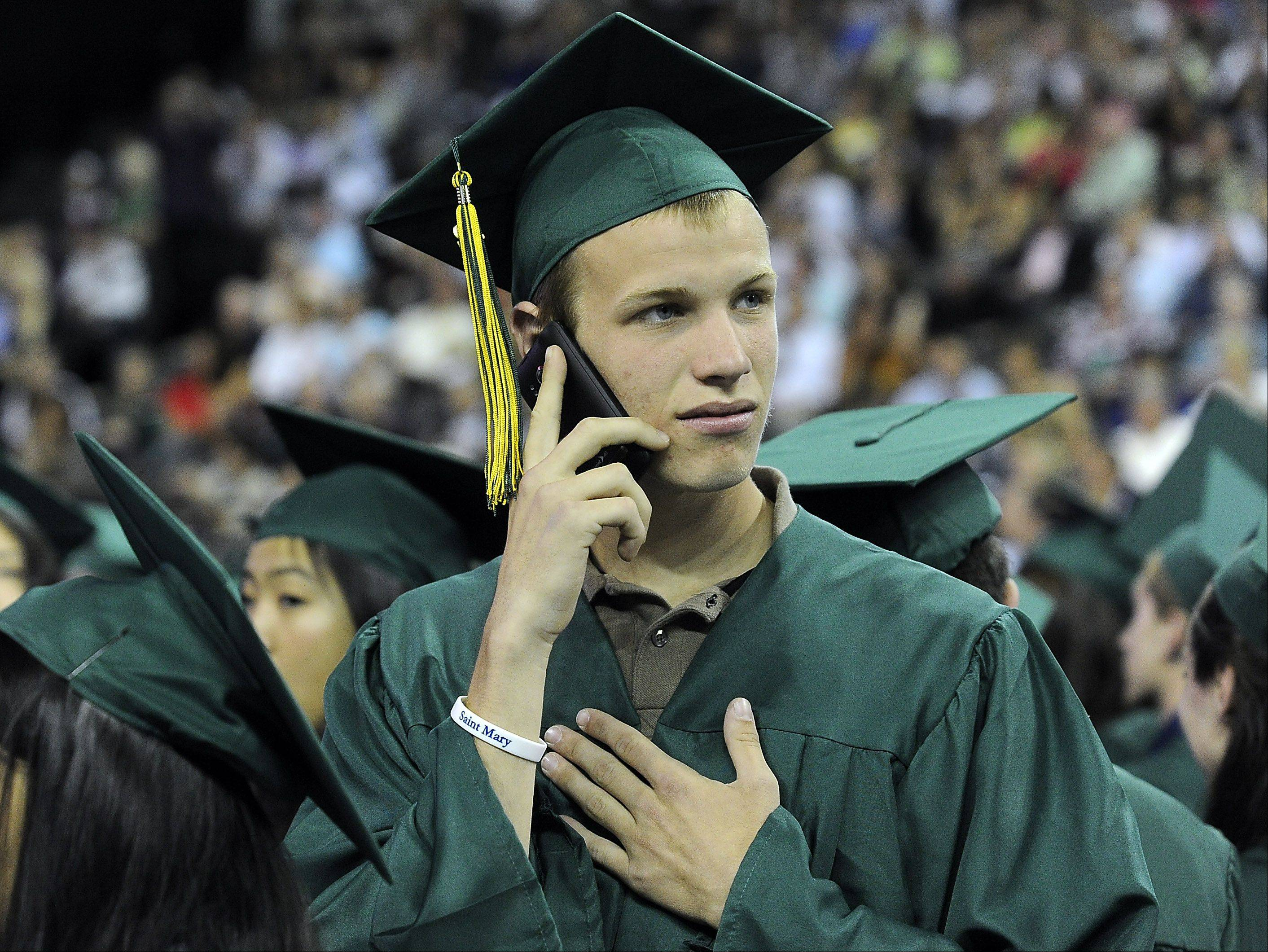 Brendan Sexson ,18, of Long Grove makes a phone call to his parents so that they can find him at the Sears Centre in Hoffman Estates on Thursday.