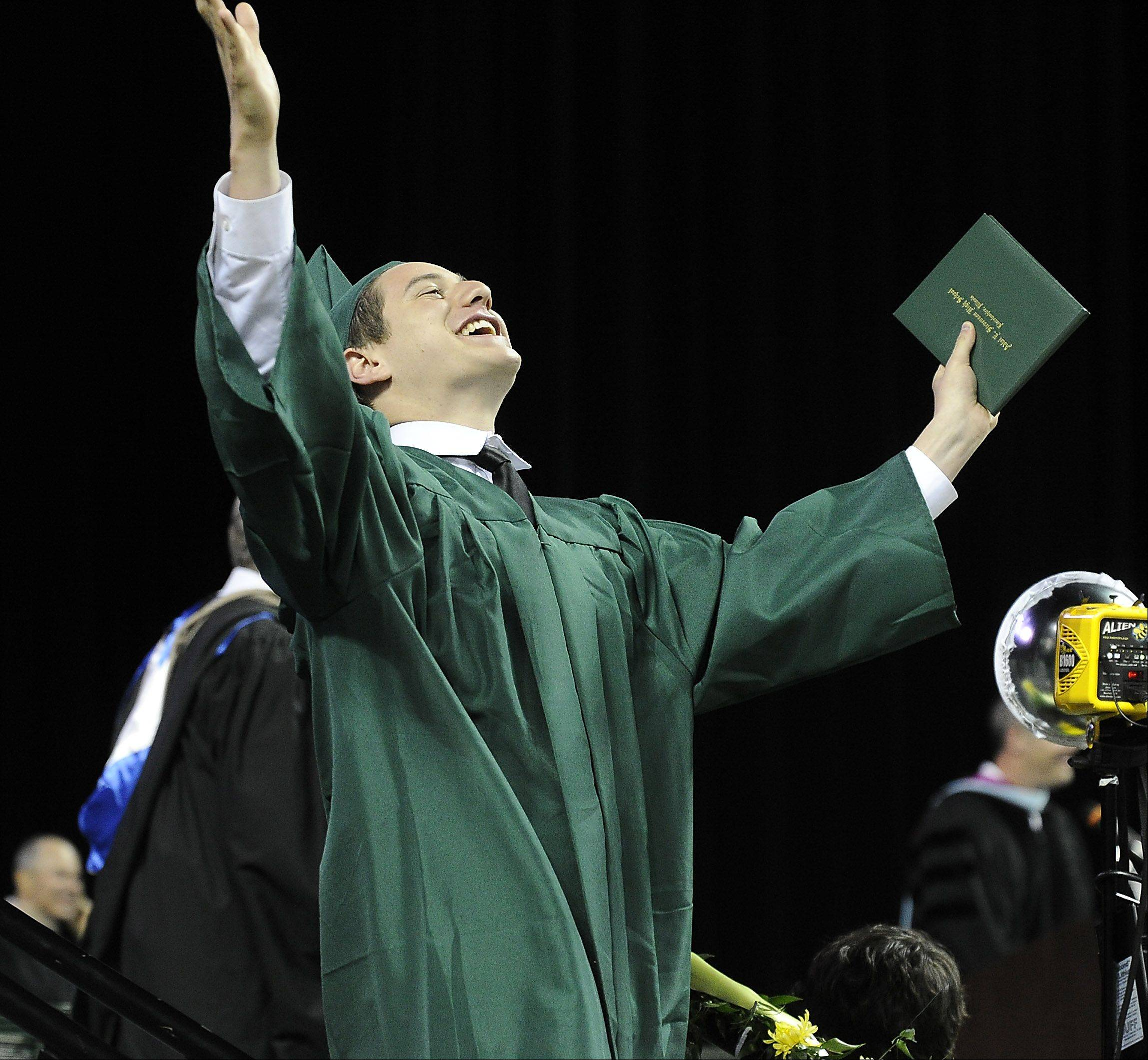 Daniel Shtivelberg ,18, of Buffalo Grove celebrates after receiving his diploma.