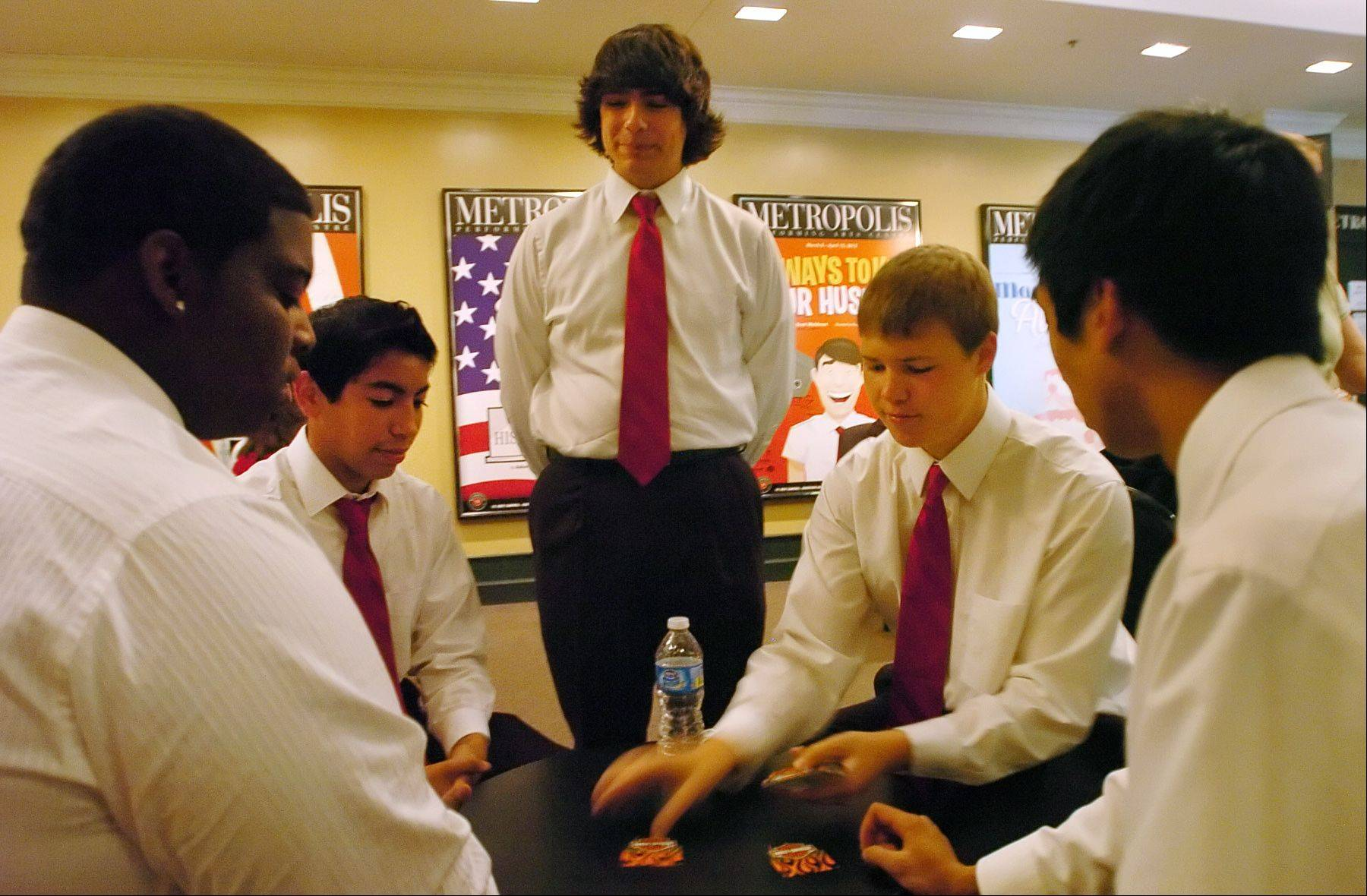 "Project Two Music of Huntley pass the time playing cards while waiting to perform a number from ""Jersey Boys"" during the Suburban Chicago's Got Talent competition at the Metropolis Performing Arts Centre."