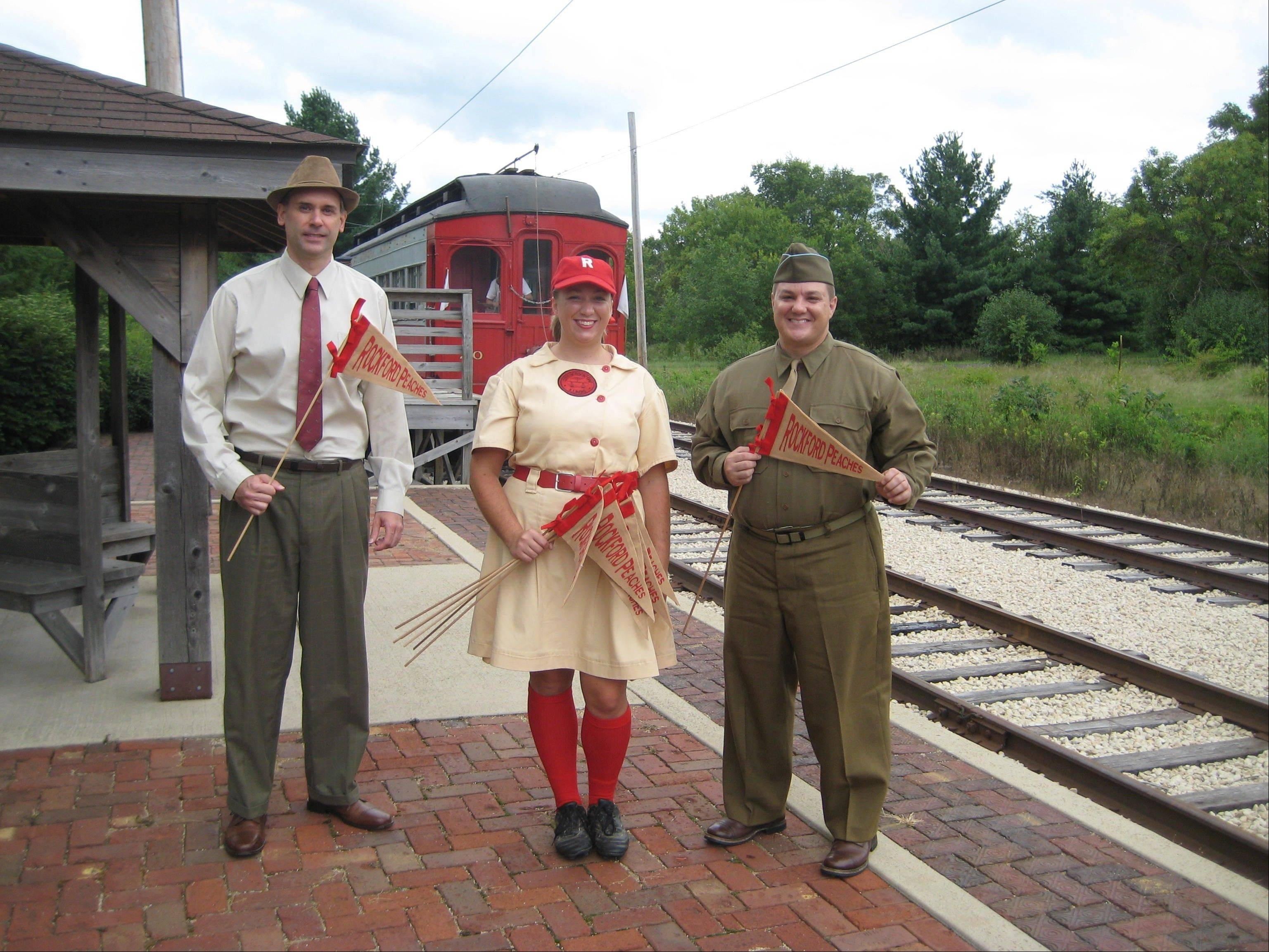 Nicole Stadie, Dan Reycraft and a third re-enactor pose before departing via trolley for the All American Girls baseball game. The game was part of the Fox Trolley Museum's living history event last year.