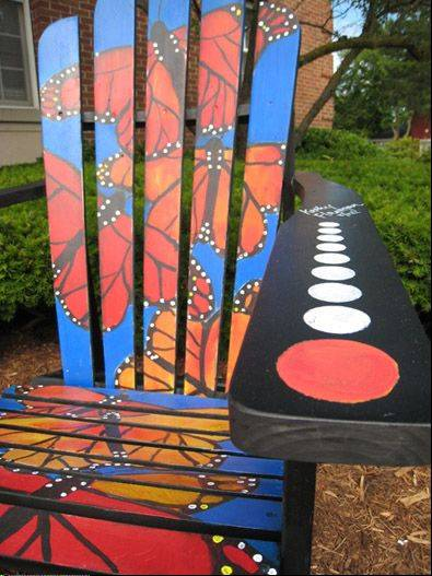One Of The Painted Adirondack Chairs Sits Along Main Street In Downtown  Wauconda.