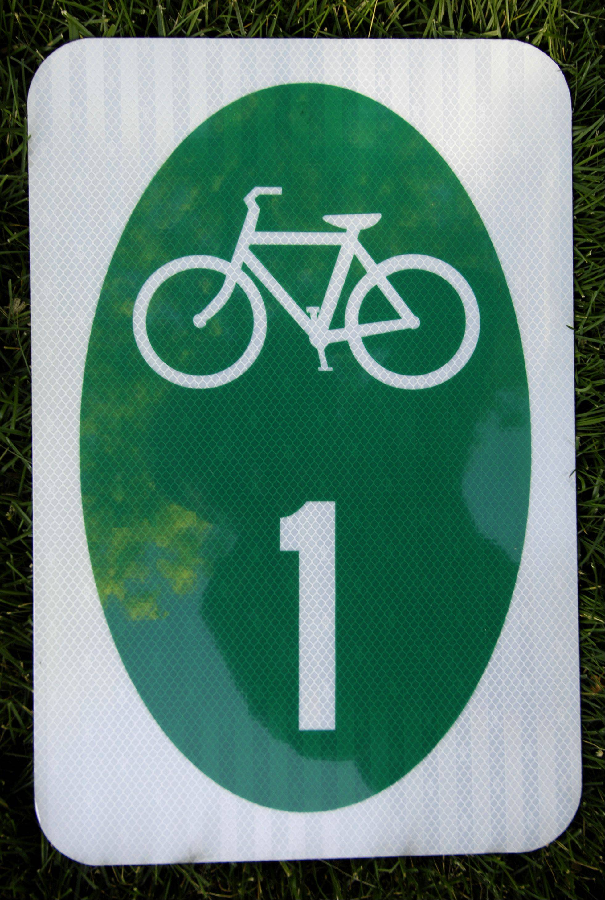 Adding bike route signs to Carol Stream streets would be a less-expensive option than building off-street paths, according to bicycling enthusiast Robert Guico.