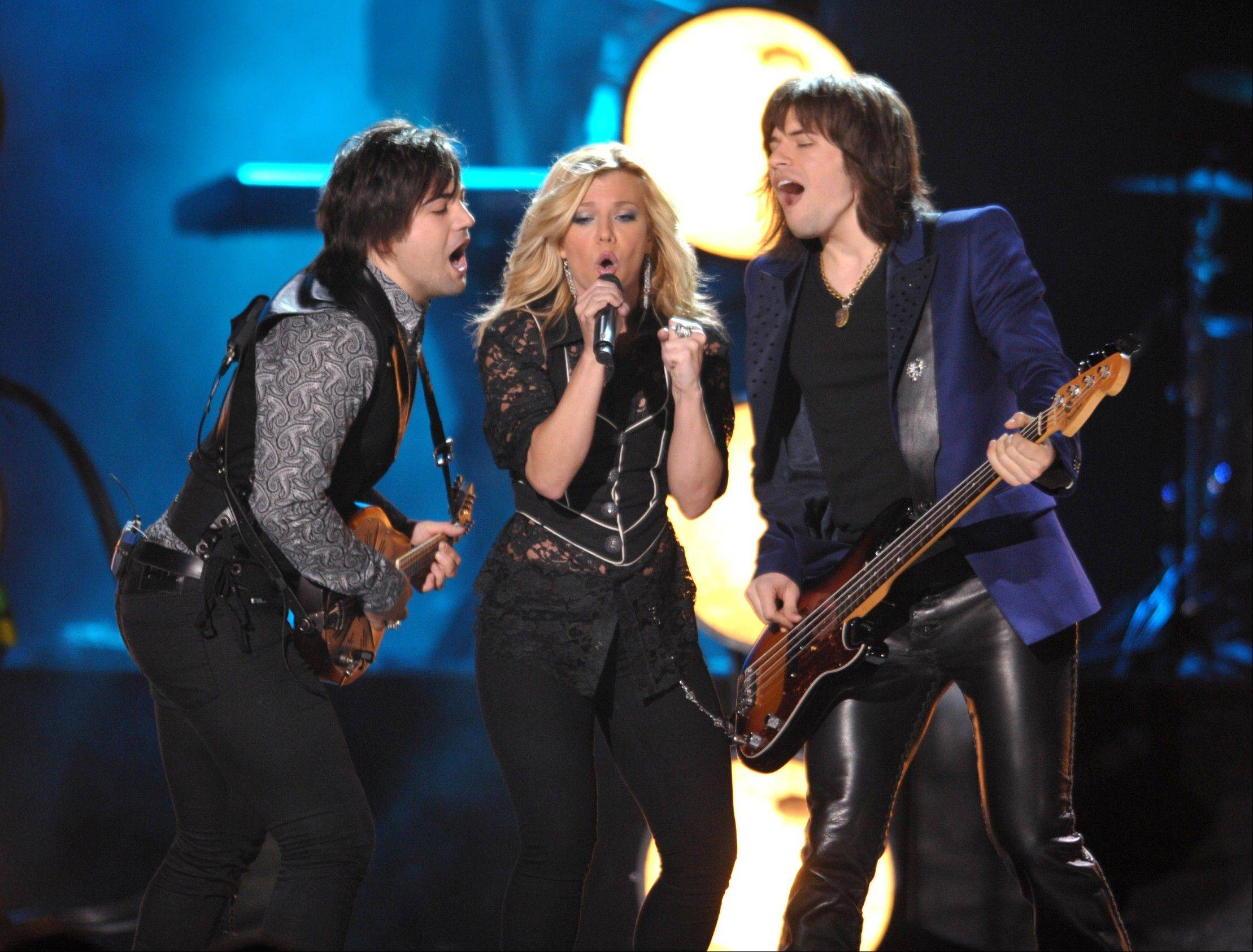 From left, Neil Perry, Kimberly Perry and Reid Perry of The Band Perry perform at the 2012 CMT Music Awards on Wednesday, June 6, 2012 in Nashville, Tenn.