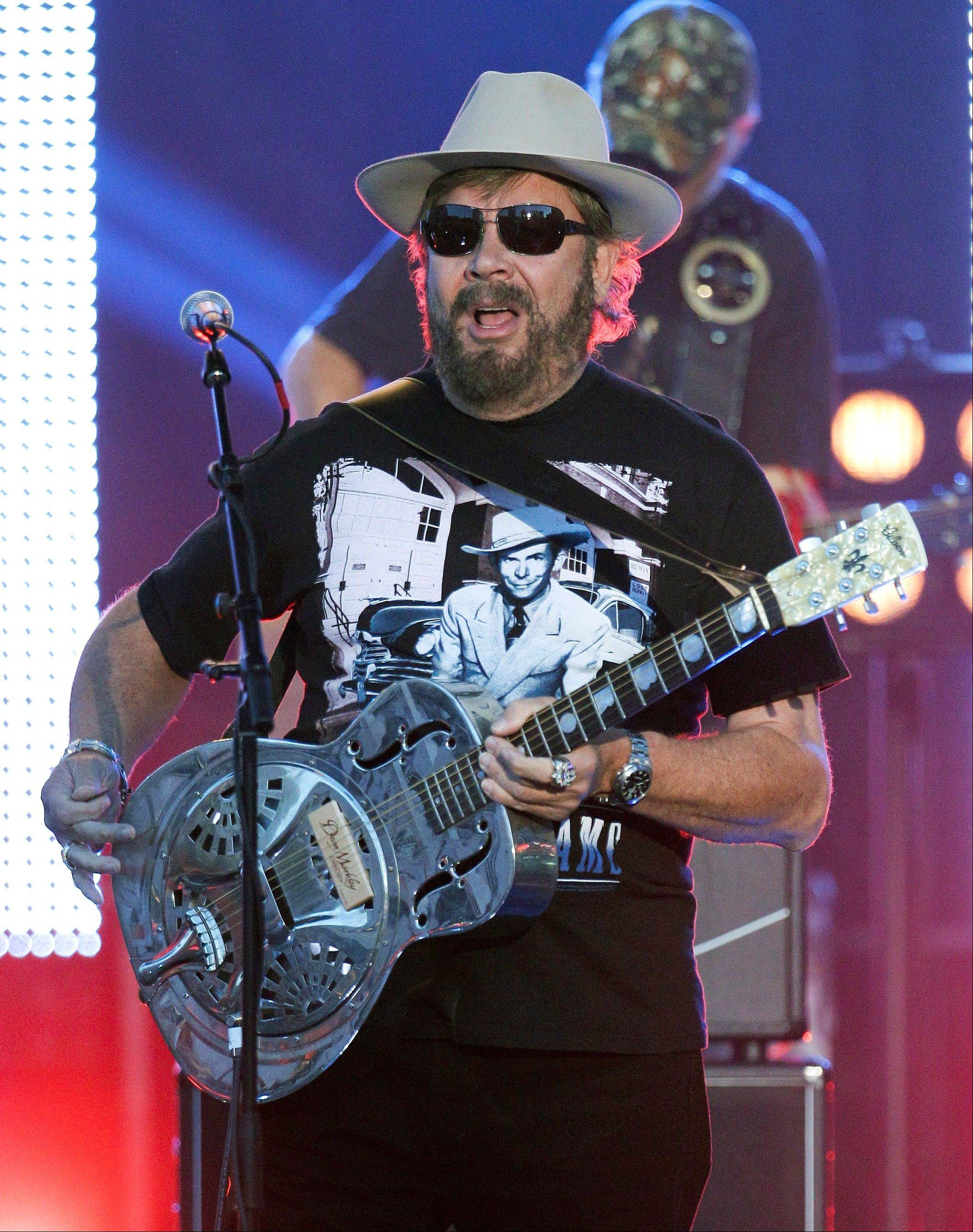 Hank Williams Jr. performs on an outdoor stage during the CMT Music Awards show on Wednesday, June 6, 2012, in Nashville, Tenn.