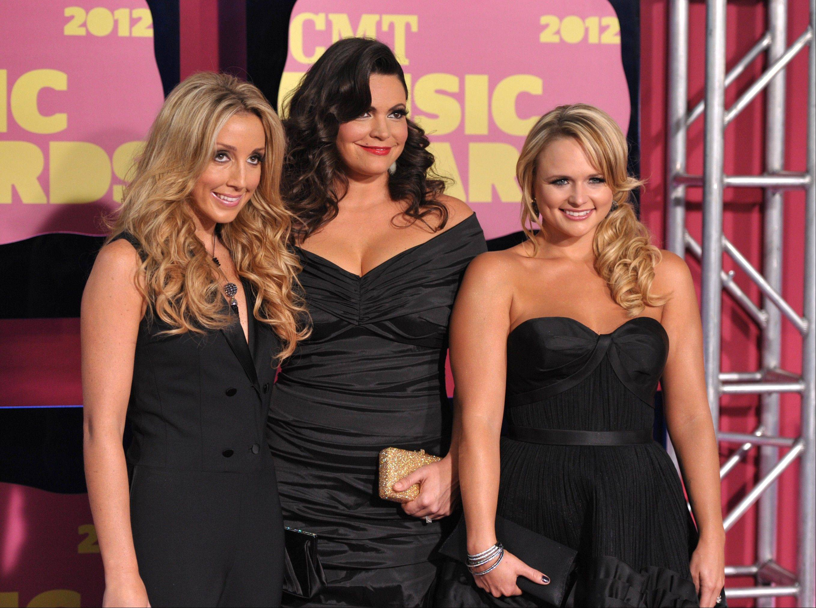 From left, Ashley Monroe, Angaleena Presley and Miranda Lambert of Pistol Annies arrive at the 2012 CMT Music Awards on Wednesday, June 6, 2012 in Nashville, Tenn.