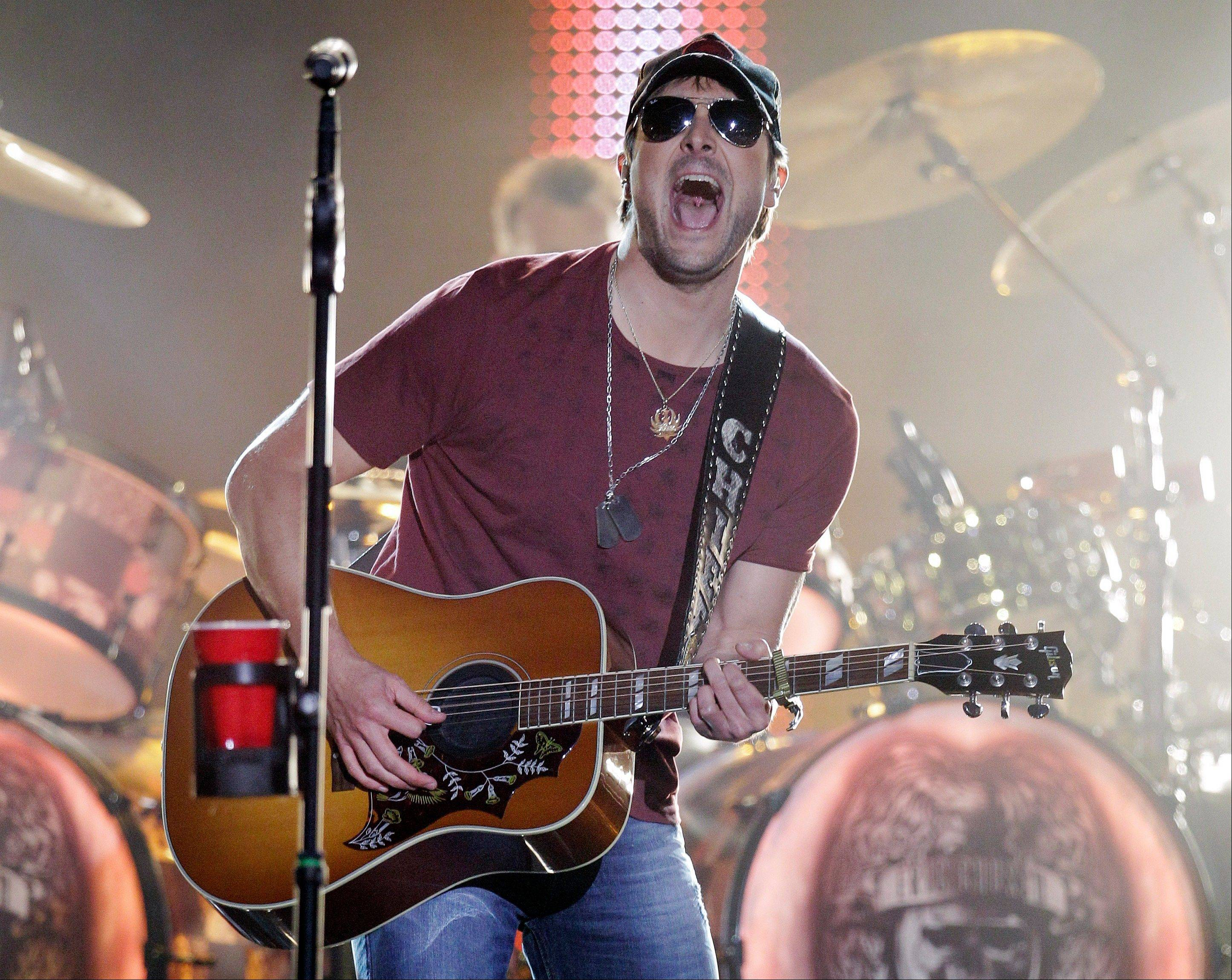 Eric Church performs on an outdoor stage during the CMT Music Awards show on Wednesday, June 6, 2012, in Nashville, Tenn.