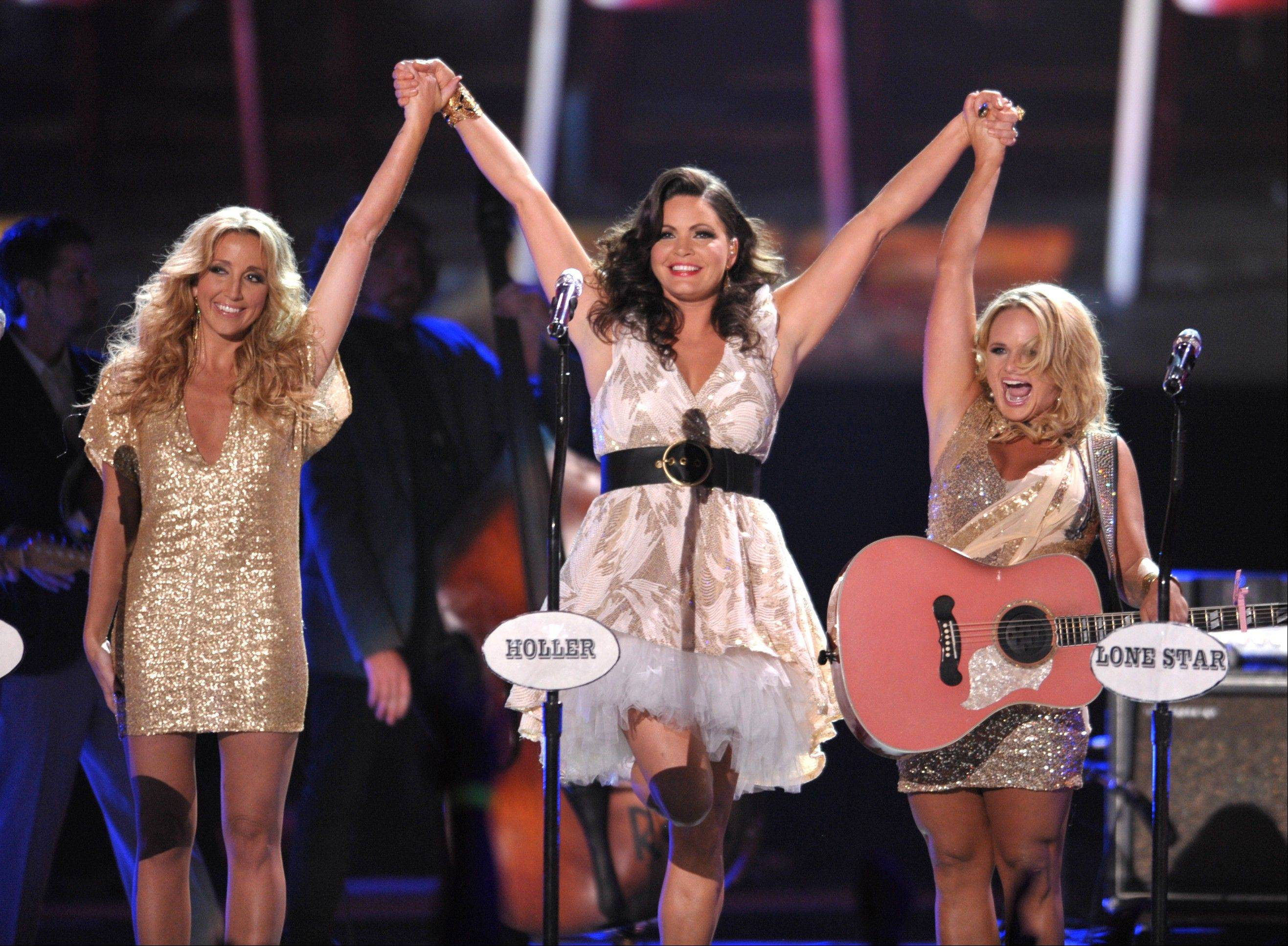 From left, Ashley Monroe, Angaleena Presley and Miranda Lambert of Pistol Annies perform at the 2012 CMT Music Awards on Wednesday, June 6, 2012 in Nashville, Tenn.