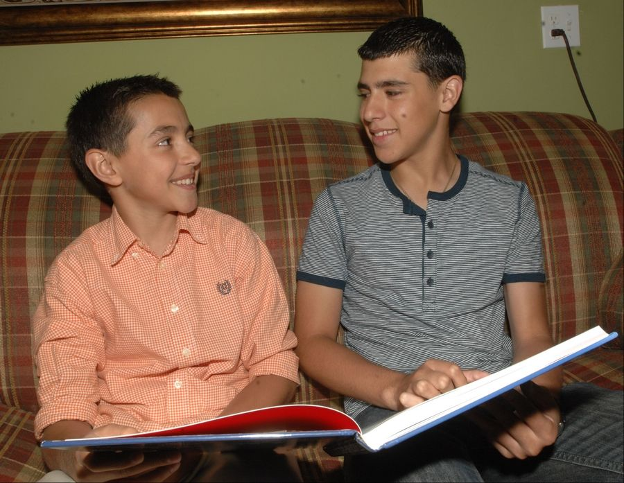 "Meliton Chaidez of Aurora won a regional speech contest and will represent Illinois and Iowa in a national contest. Here he is with Raul, one of his two older brothers.""Both of my brothers are growing up to be great, they're really great,"" Meliton said. ""Those are big shoes to fill."""