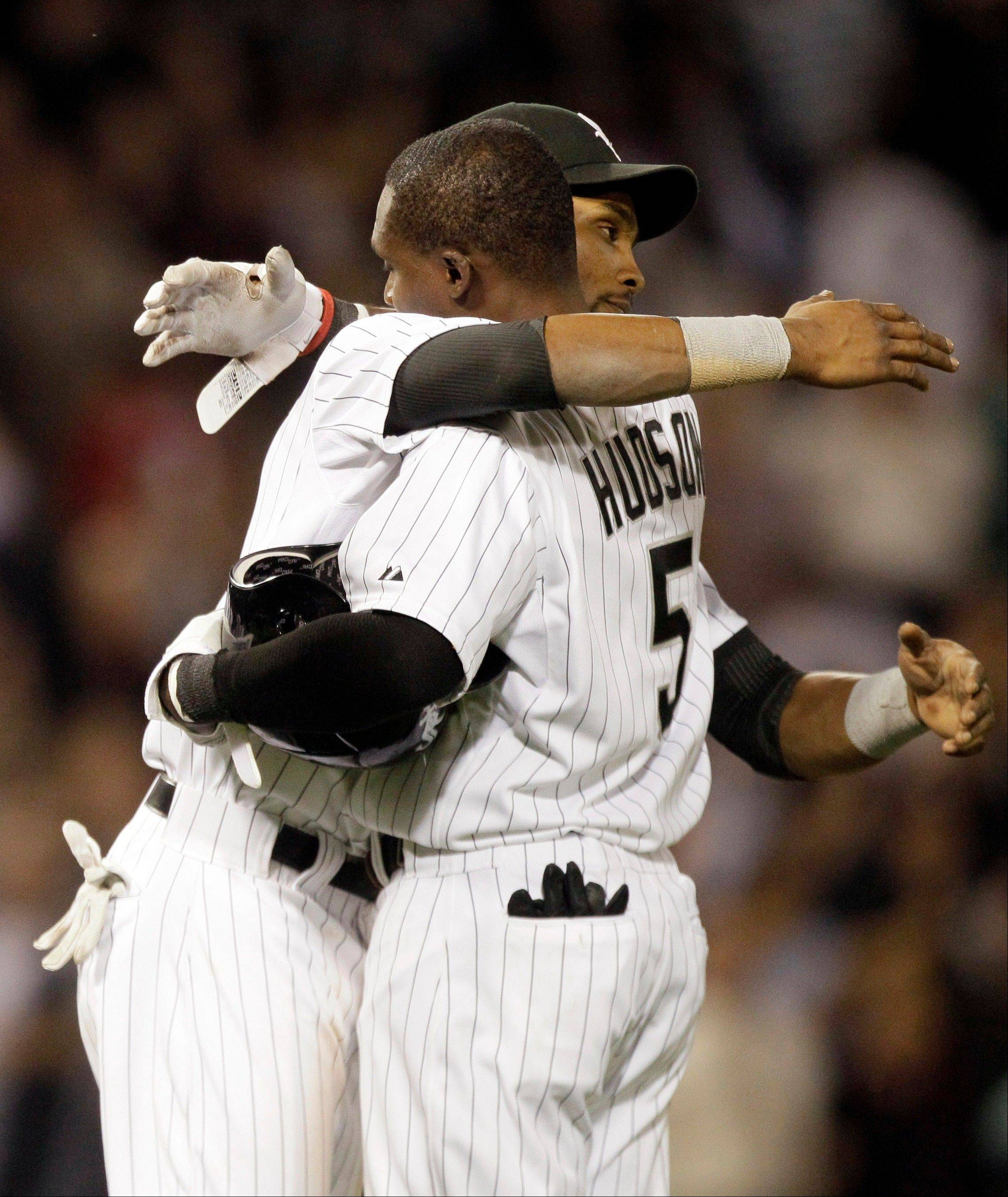 The White Sox' Orlando Hudson gets a hug from Alexei Ramirez after his game-winning single in the night inning against the Toronto Blue Jays on Thursday night.