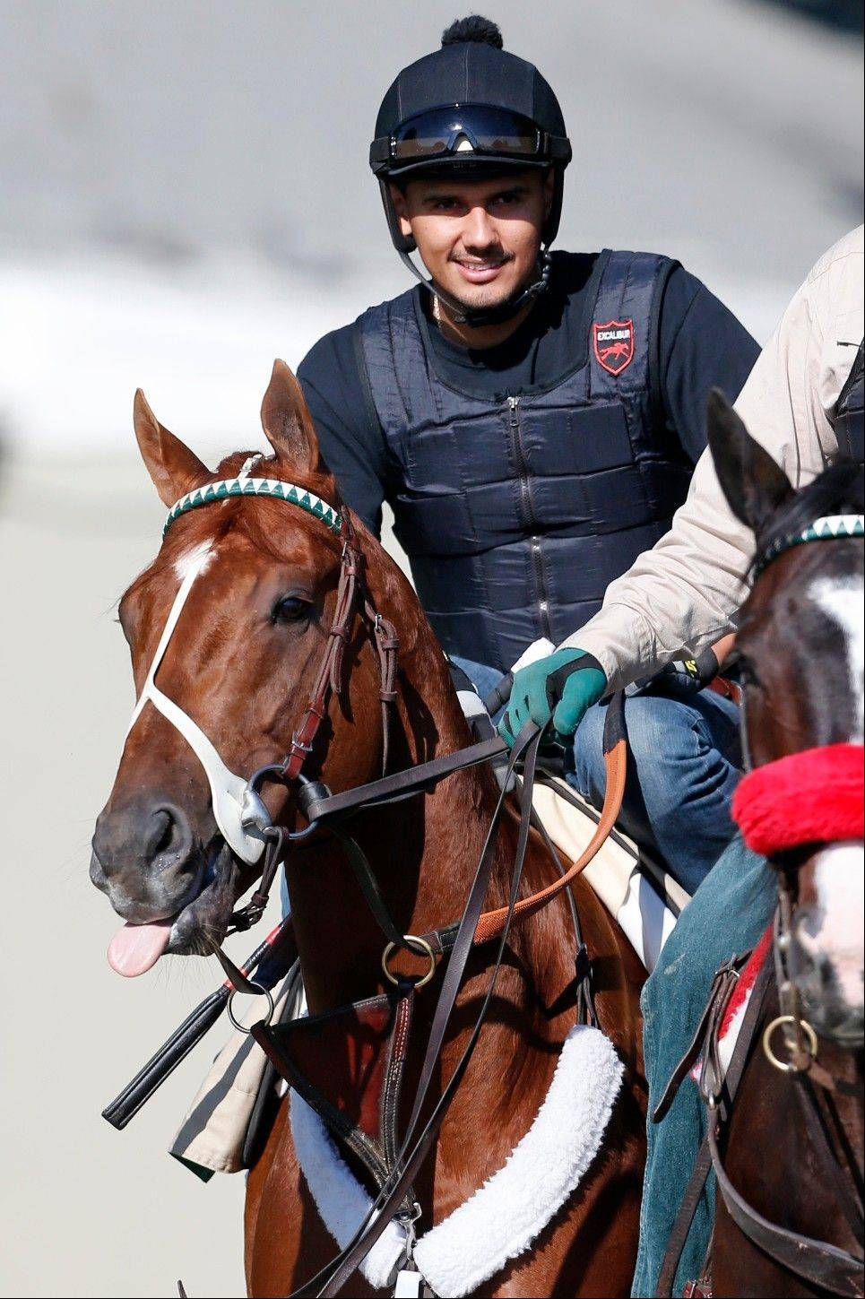 I'll Have Another, here with exercise rider Jonny Garcia up, has a lot of naysayers thinking he won't be able to handle monster oval at Belmont on Saturday. Mike Spellman says don't believe them.