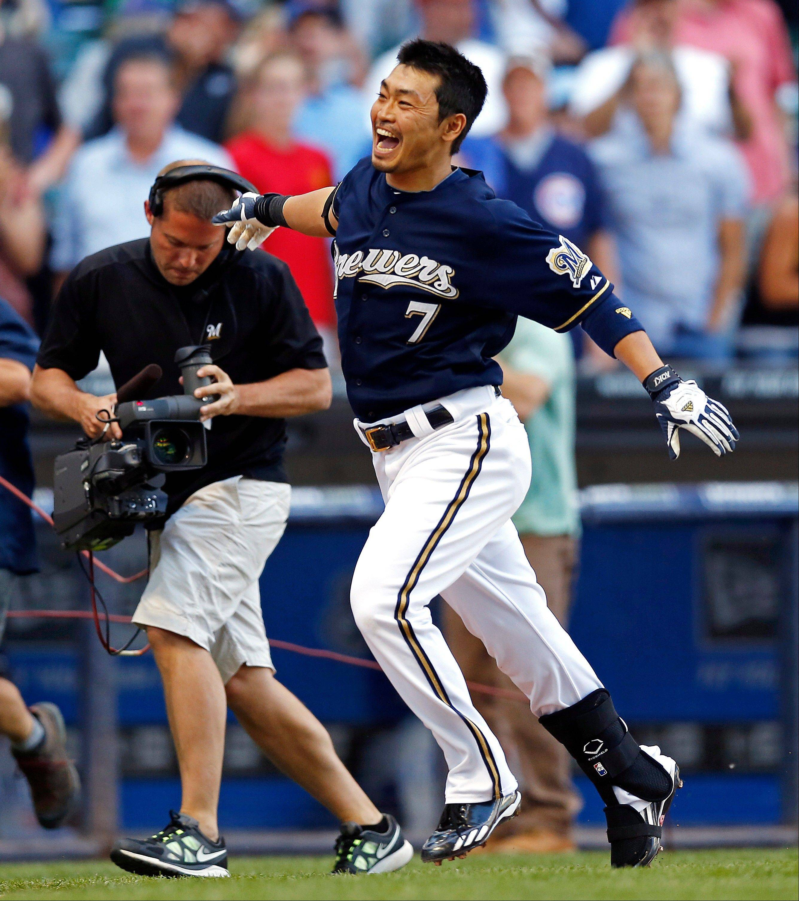 The Brewers' Norichika Aoki celebrates his walk-off home run to defeat the Cubs on Thursday in 10 innings.