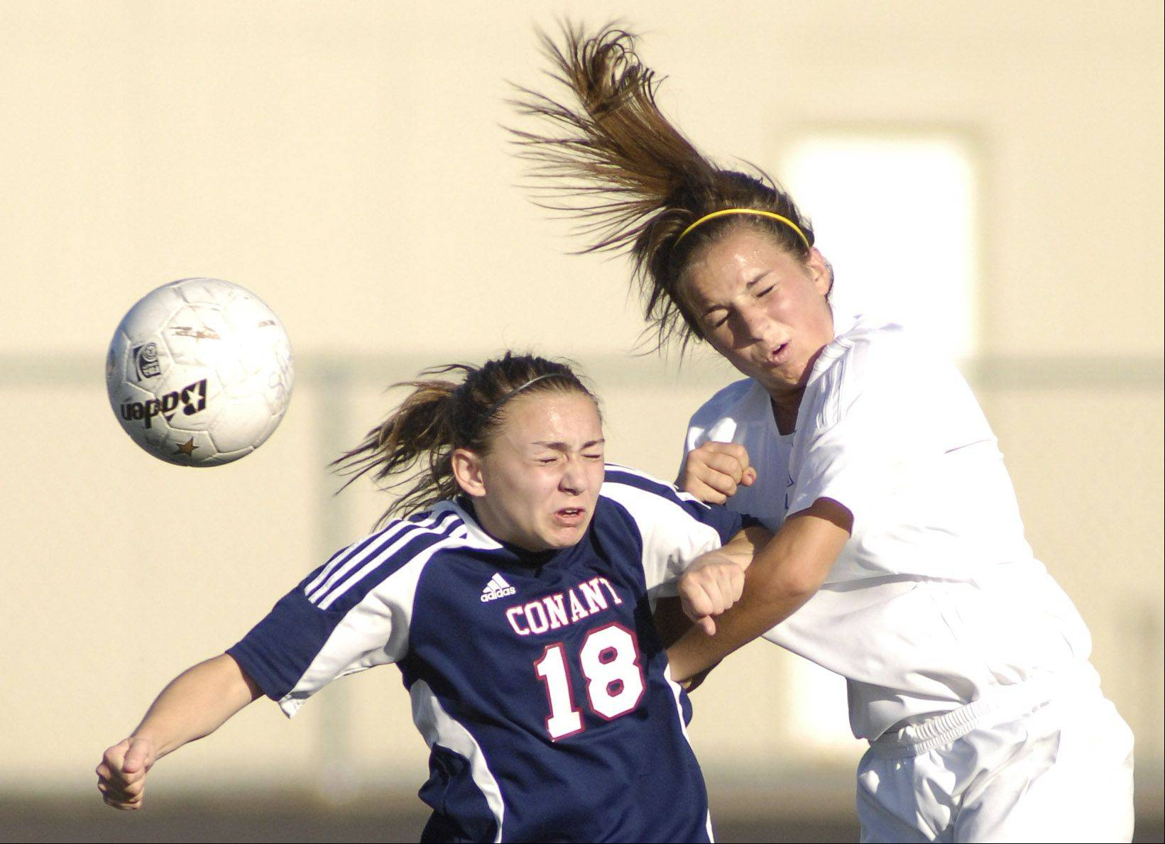 Conant's Courtney Raetzman and St. Charles North's Maryl Behm battle.