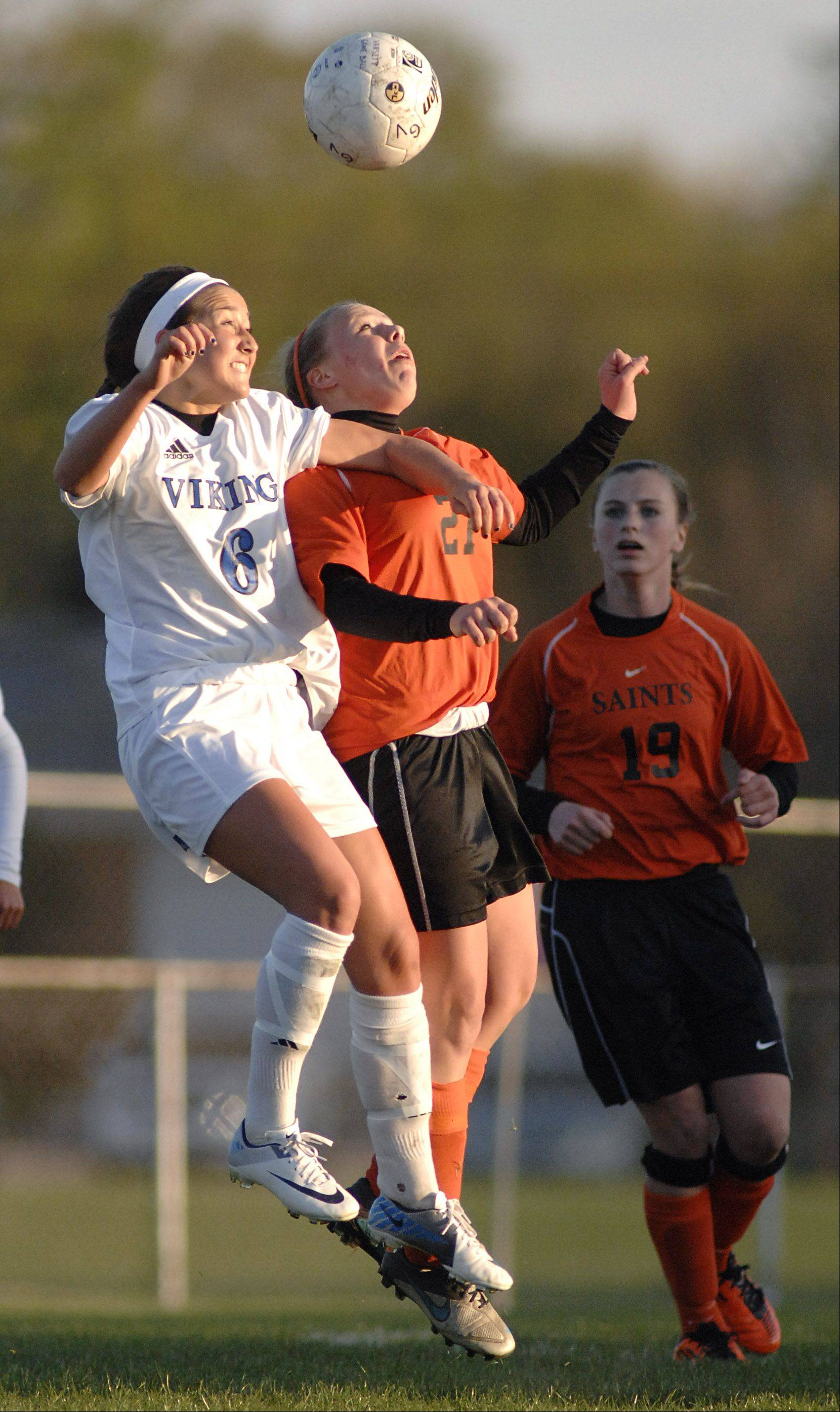 St. Charles East's Amanda Hilton and Geneva's Catherine Allon go for the ball.