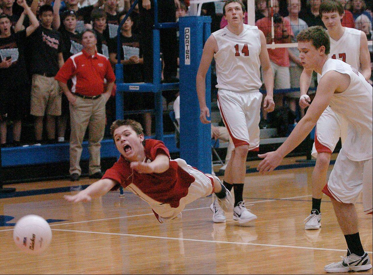 Austin Czarnecki of Barrington dives for a ball.