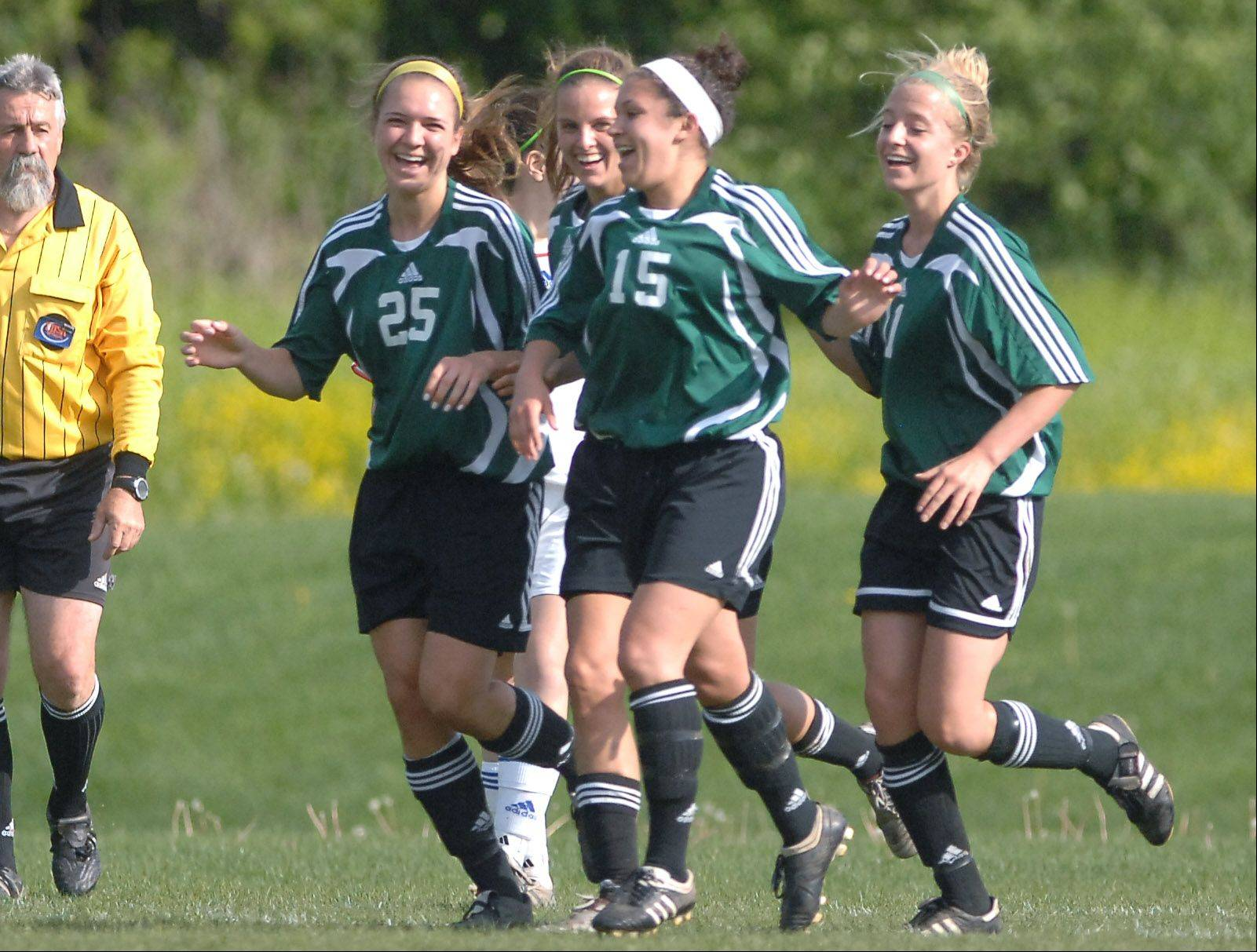 Stevenson players from left Katie Krejsa, Nicole Sodomire, Jackie Wynn and Jo Jo Kurth celebrate.