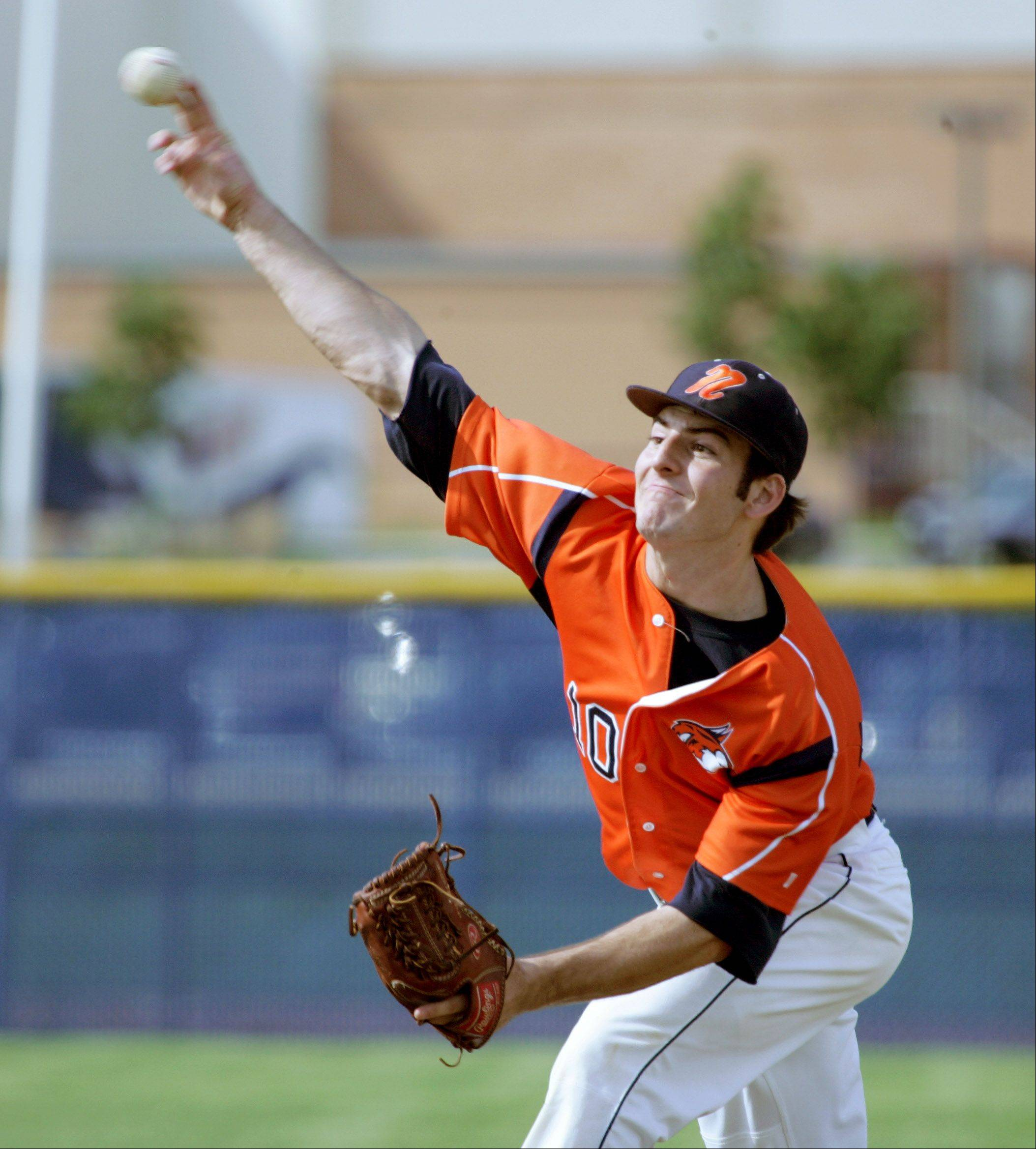 Mariano Long of Naperville North pitches against Downers Grove North .