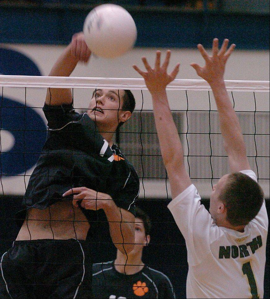 Thomas Jaeschke of Wheaton Warrenville South goes for a spike.