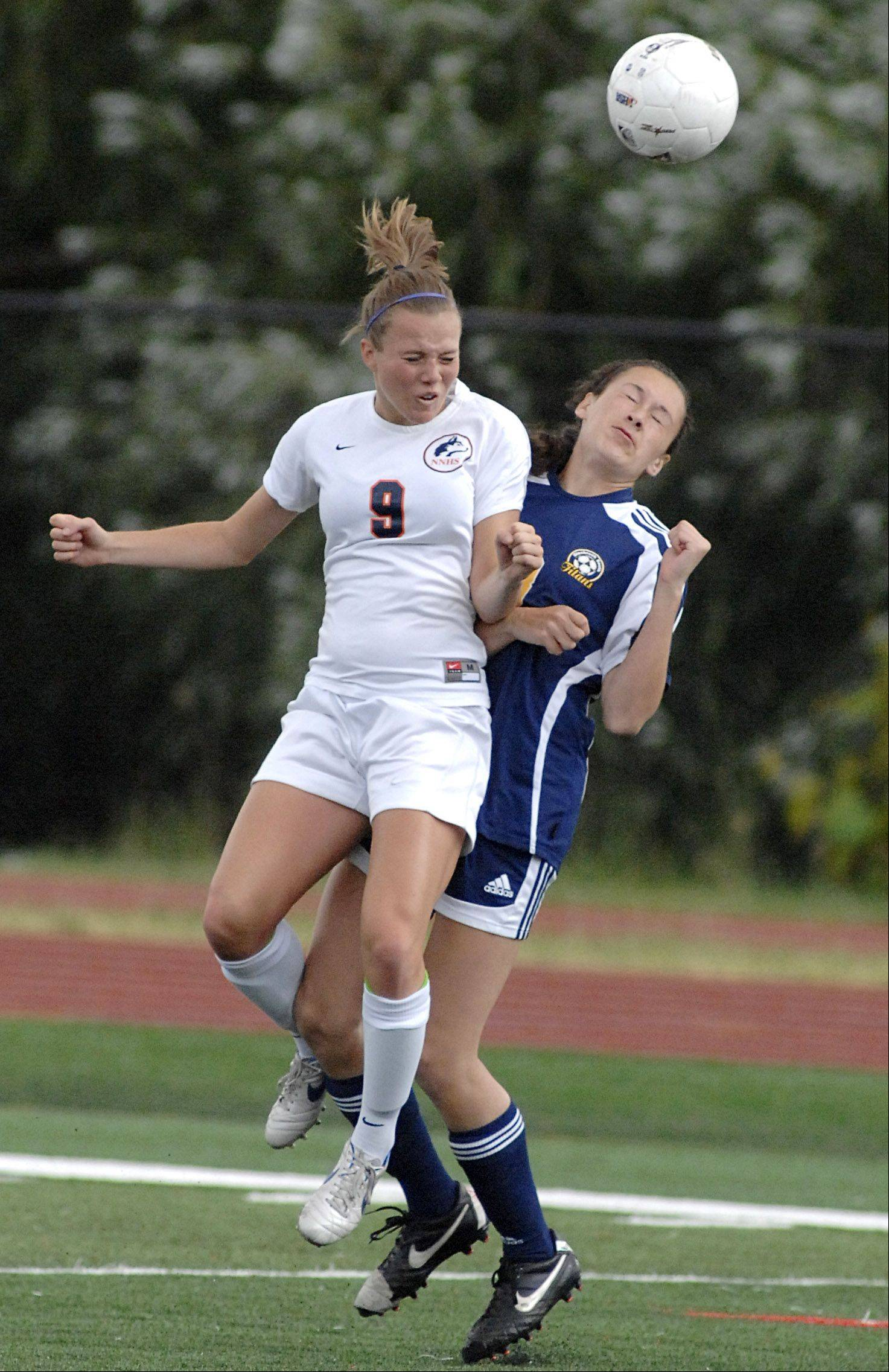 Glenbrook South's Nicole Sroubek collides with Naperville North's Jen Korn.