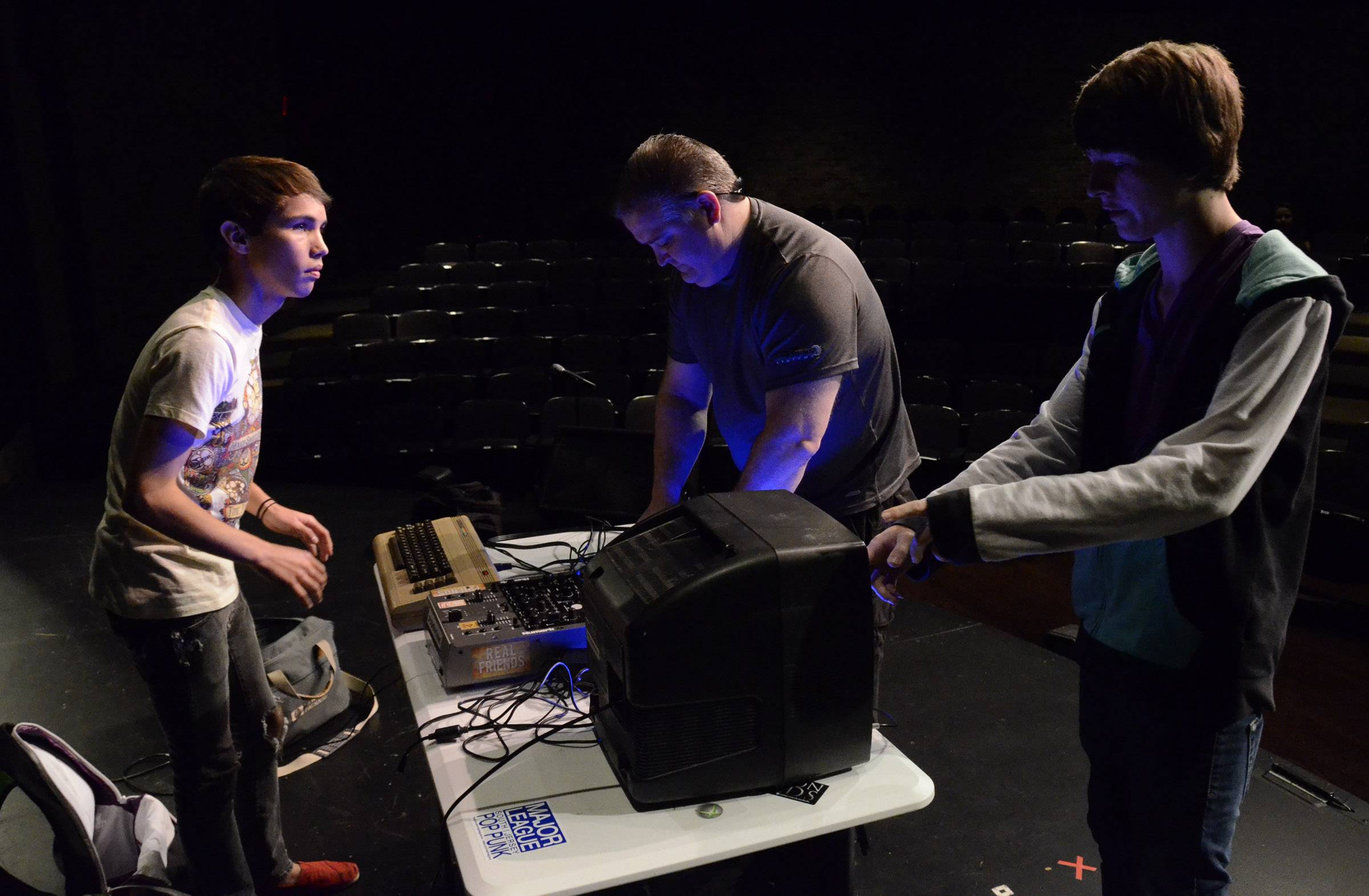 """Sophmore 64"" duo Jake Basala, 16, right, and Calvin Hughes, 17, both of Lindenhurst, and a parent set up a Commodore 64 and two Game Boys to create music Friday during auditions for Suburban Chicago's Got Talent in Arlington Heights."