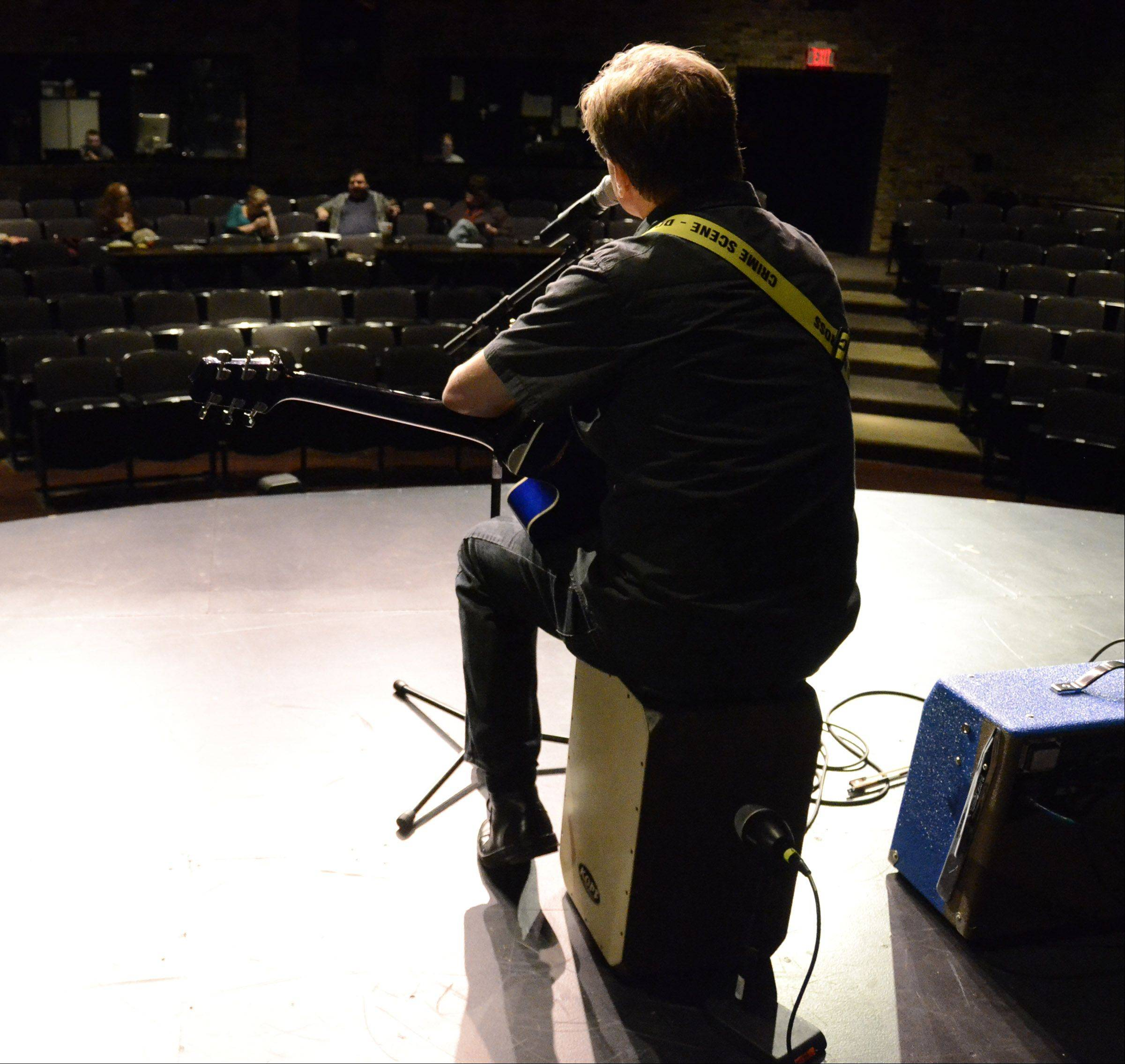 "Wesley Kochan, aka WES LeE ""K"", of Bartlett listens to judges' comments after performing."