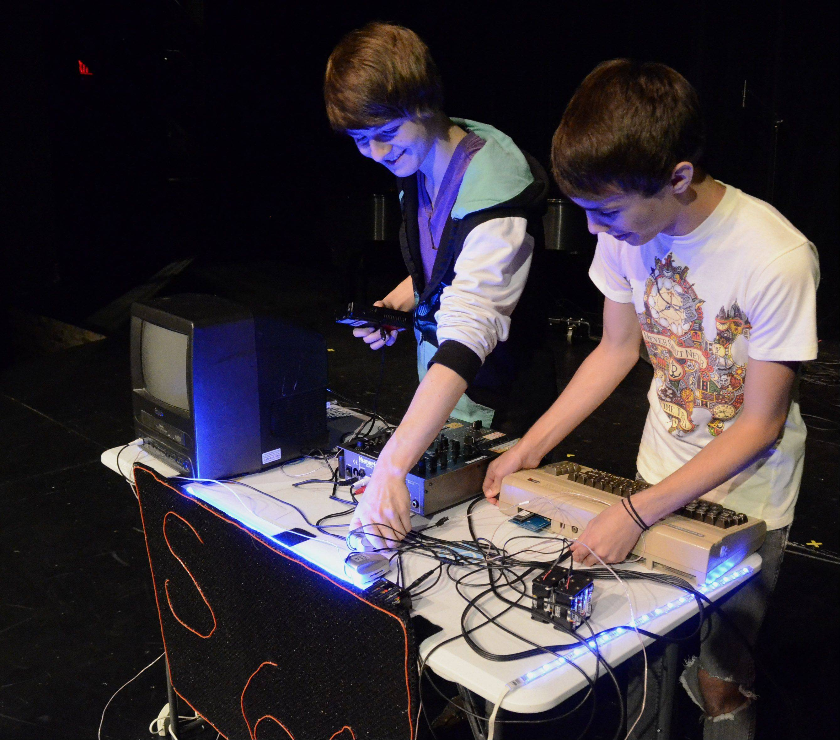 """Sophmore 64"" duo Jake Basala, 16, left, and Calvin Hughes, 17, both of LIndenhurst, preform music using a Commodore 64 and Game Boys ."