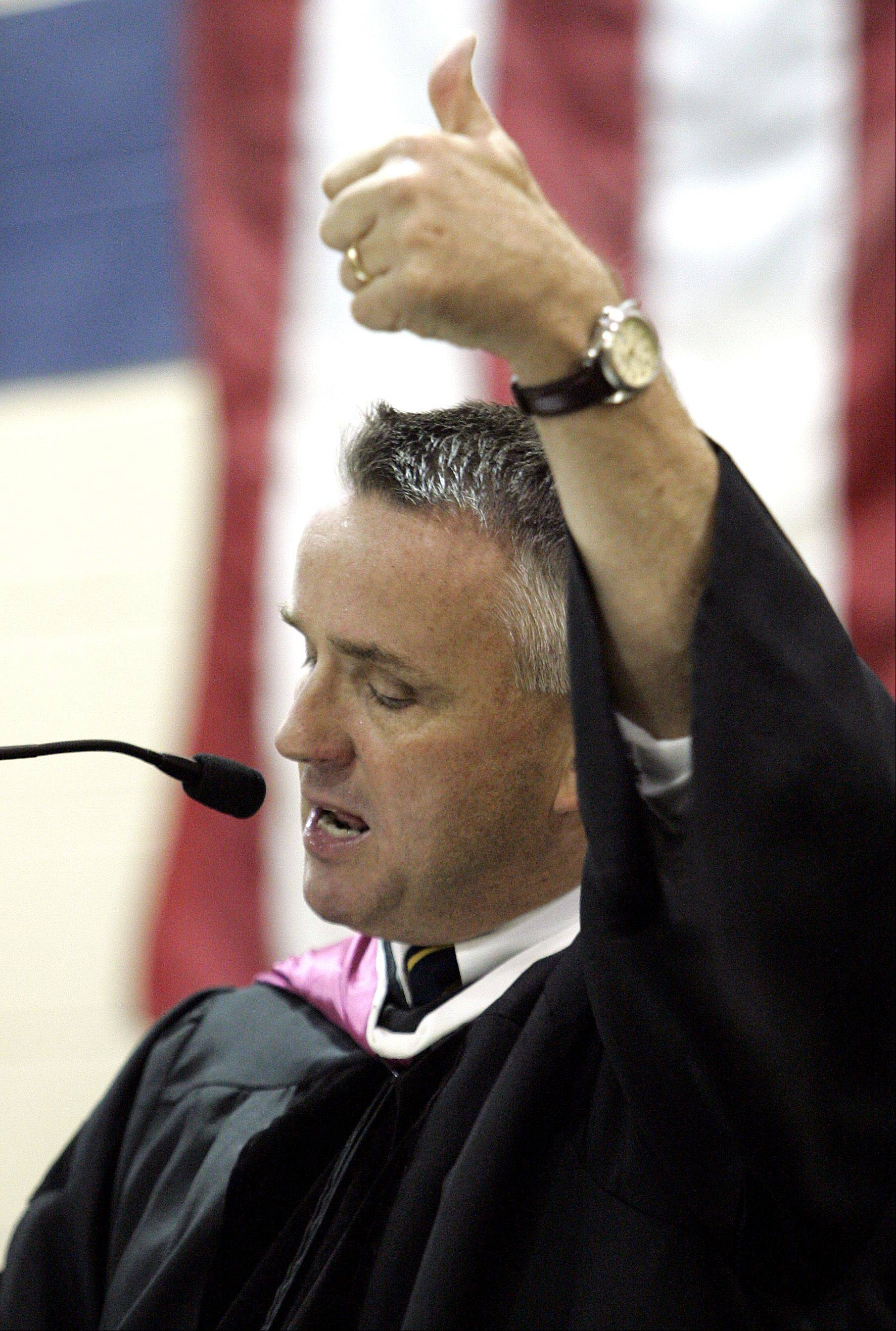 Jeff Brierton gives seniors a thumbs-up during his speech at a 2006 commencement ceremony when he was Round Lake High School's principal. He won't be moving up, as planned, from principal at Warren Township High School's O'Plaine Road campus in Gurnee to superintendent.