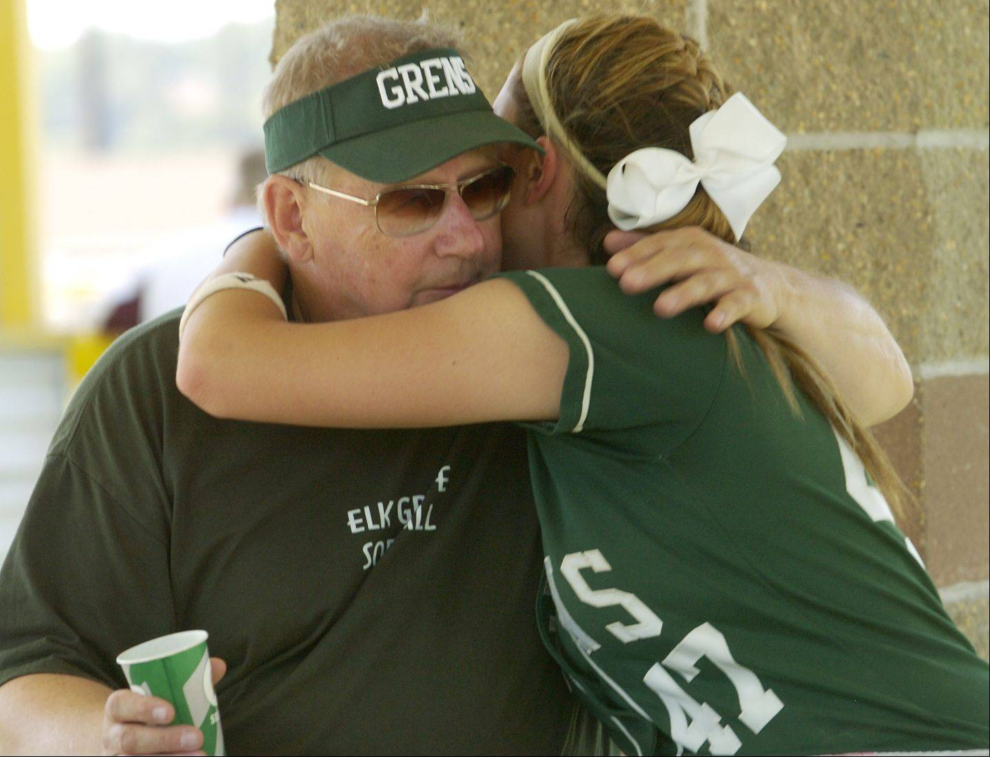 Dani Goranson is consoled by her coach, Ken Grams, after Elk Grove's loss to Marist in the Class 4A softball state semifinals.