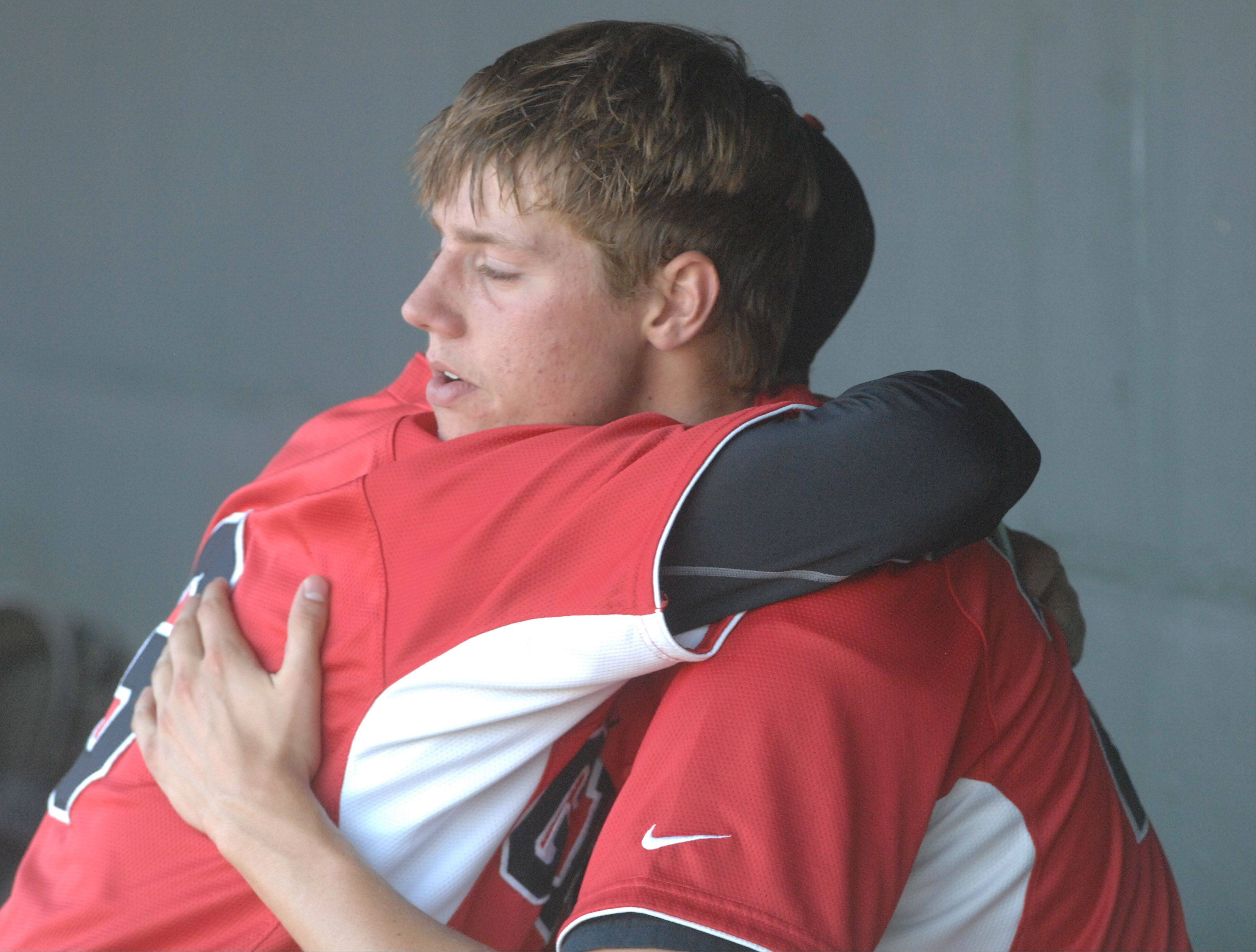 Jordan Villarreal, left, embraces Jared Helmich after Grant's loss to Oak Park-River Forest in the Class 4A state semifinals Friday at Silver Cross Field in Joliet.