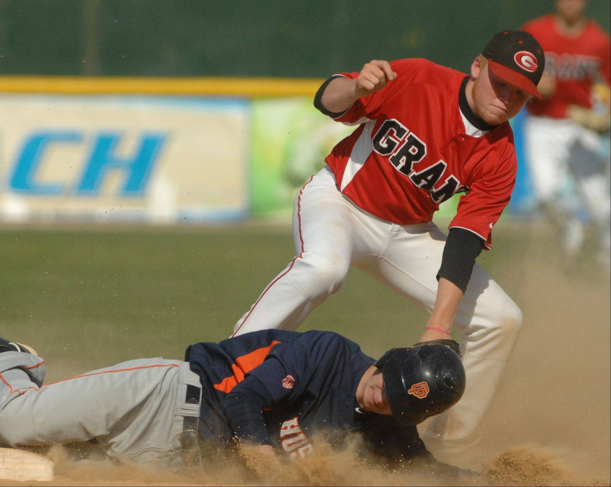 Jacob Adams of Grant puts the tag on Patrick Clifford of Oak Park-River Forest during Class 4A state semifinal play Friday at Silver Cross Field in Joliet. Clifford was safe on the play.